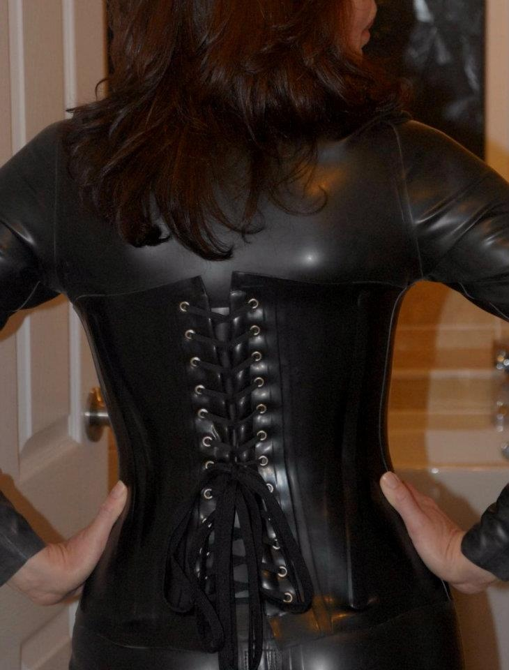 Nikki in Latex Catsuit and Tight Latex Corset by Dave Valentine