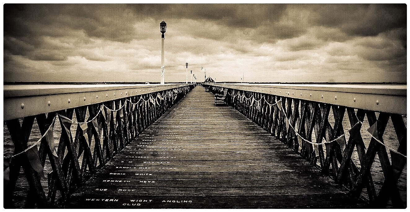 Writing on the pier  by HCPhotography