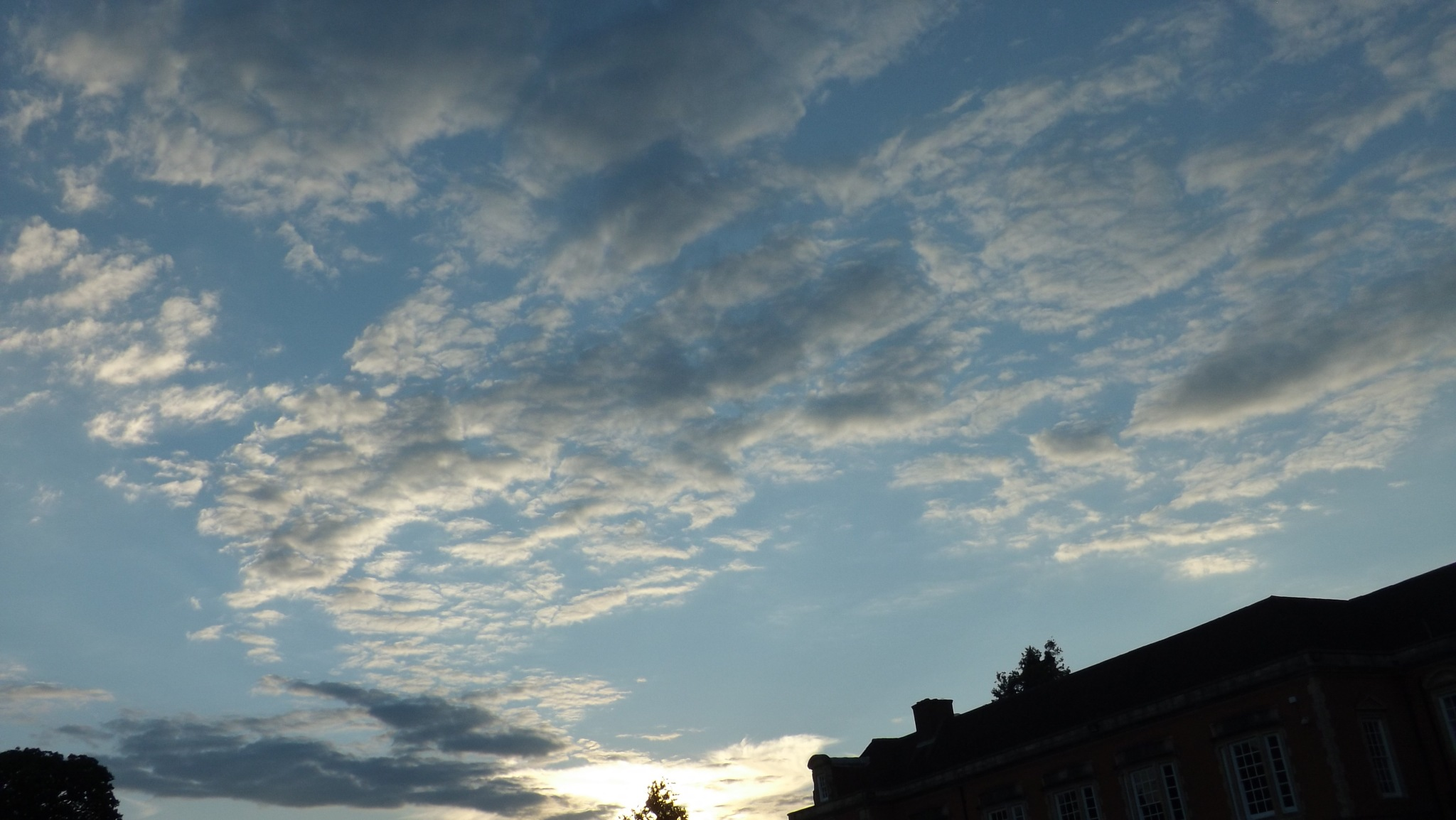 early evening clouds over buildings by beachbaby58