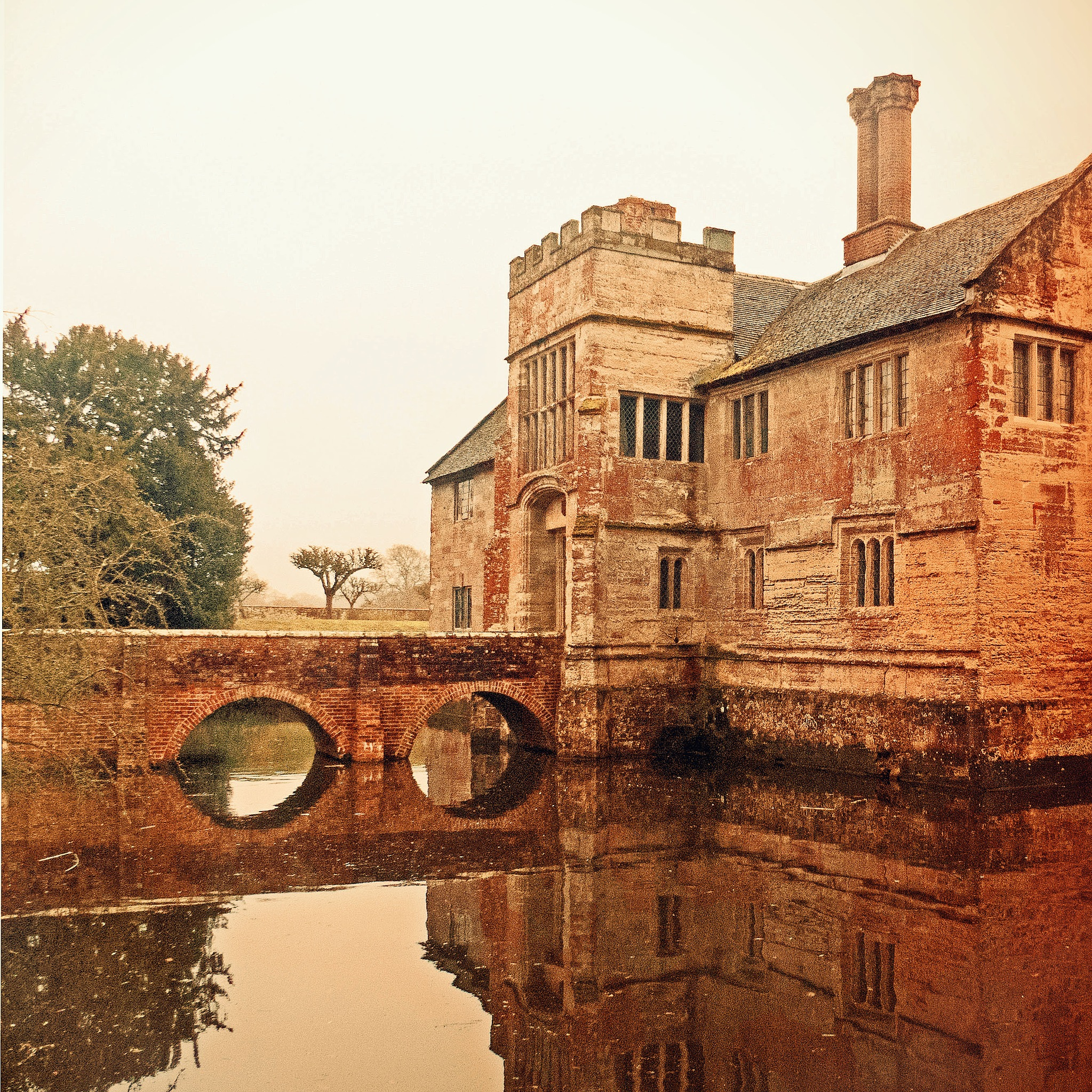 The house, bridge and moat Baddesley Clinton by Terence Quinn