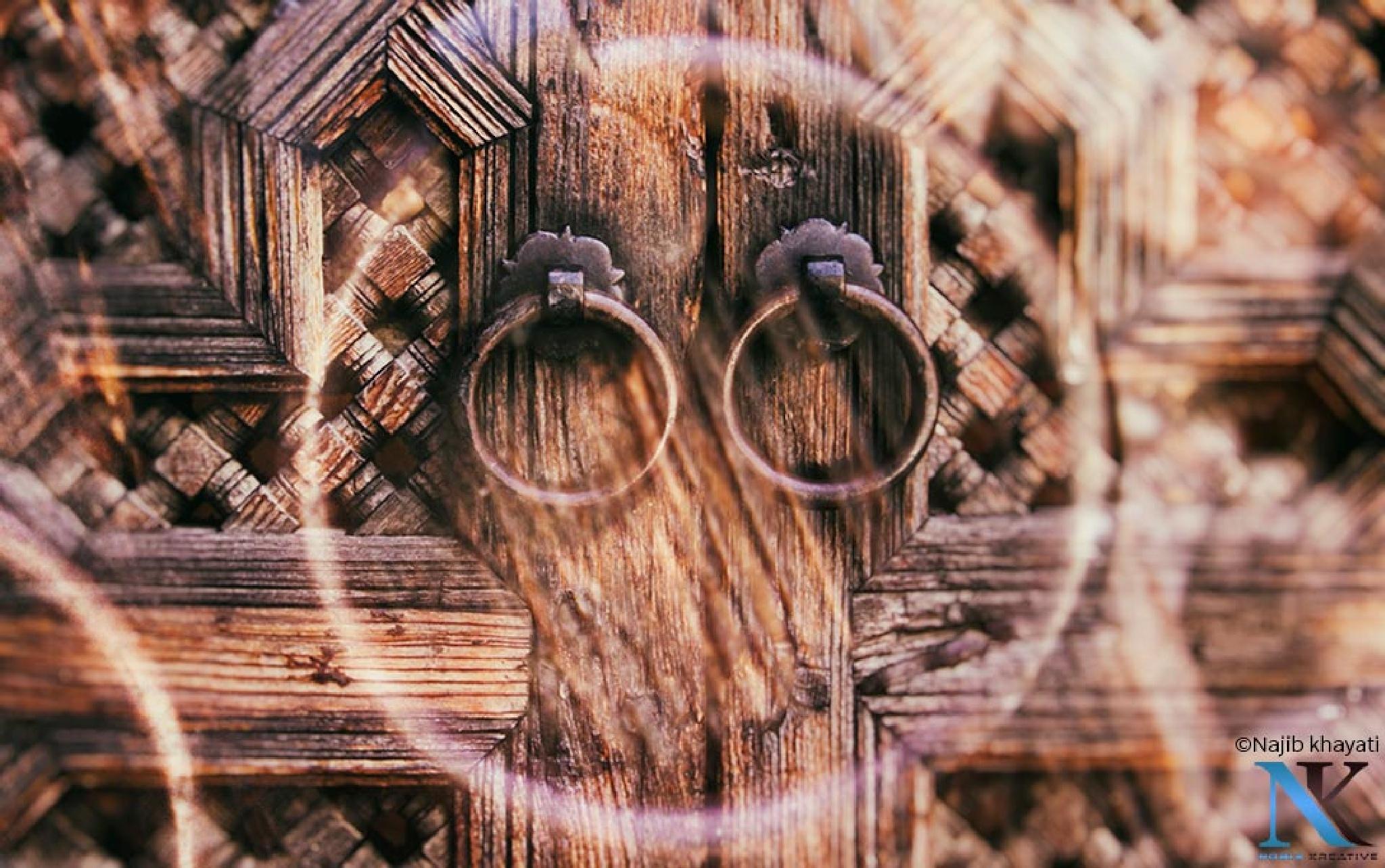 Historic wooden door by Najib Khayati