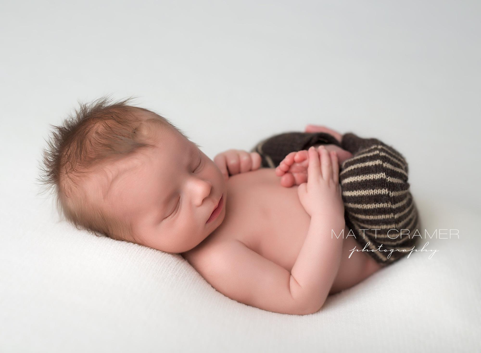 Sleeping newborn in sleep pants by Los Angeles Newborn Photography | Matt Cramer Photography