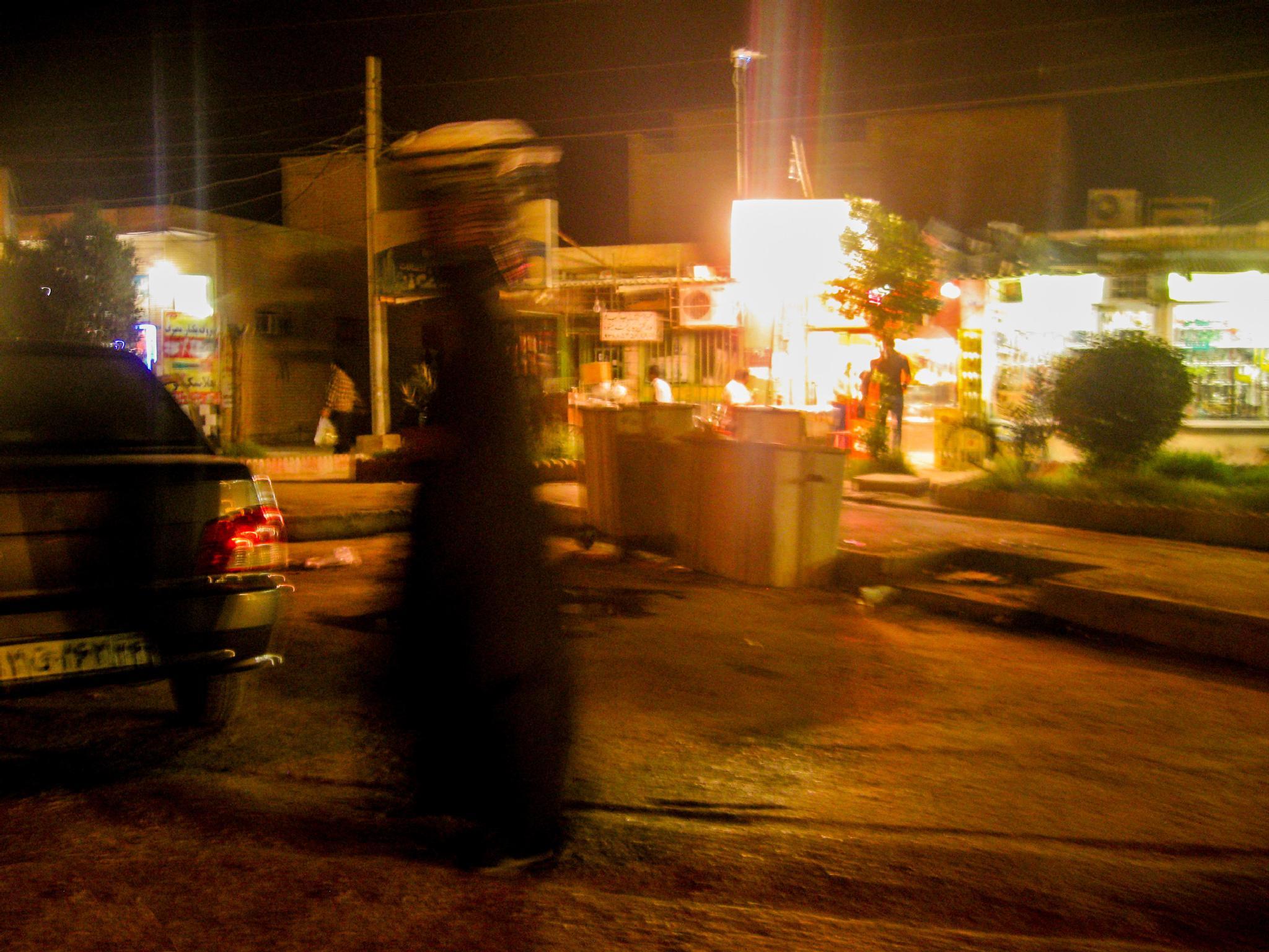 woman and Bazaar by Ahmad Safaii