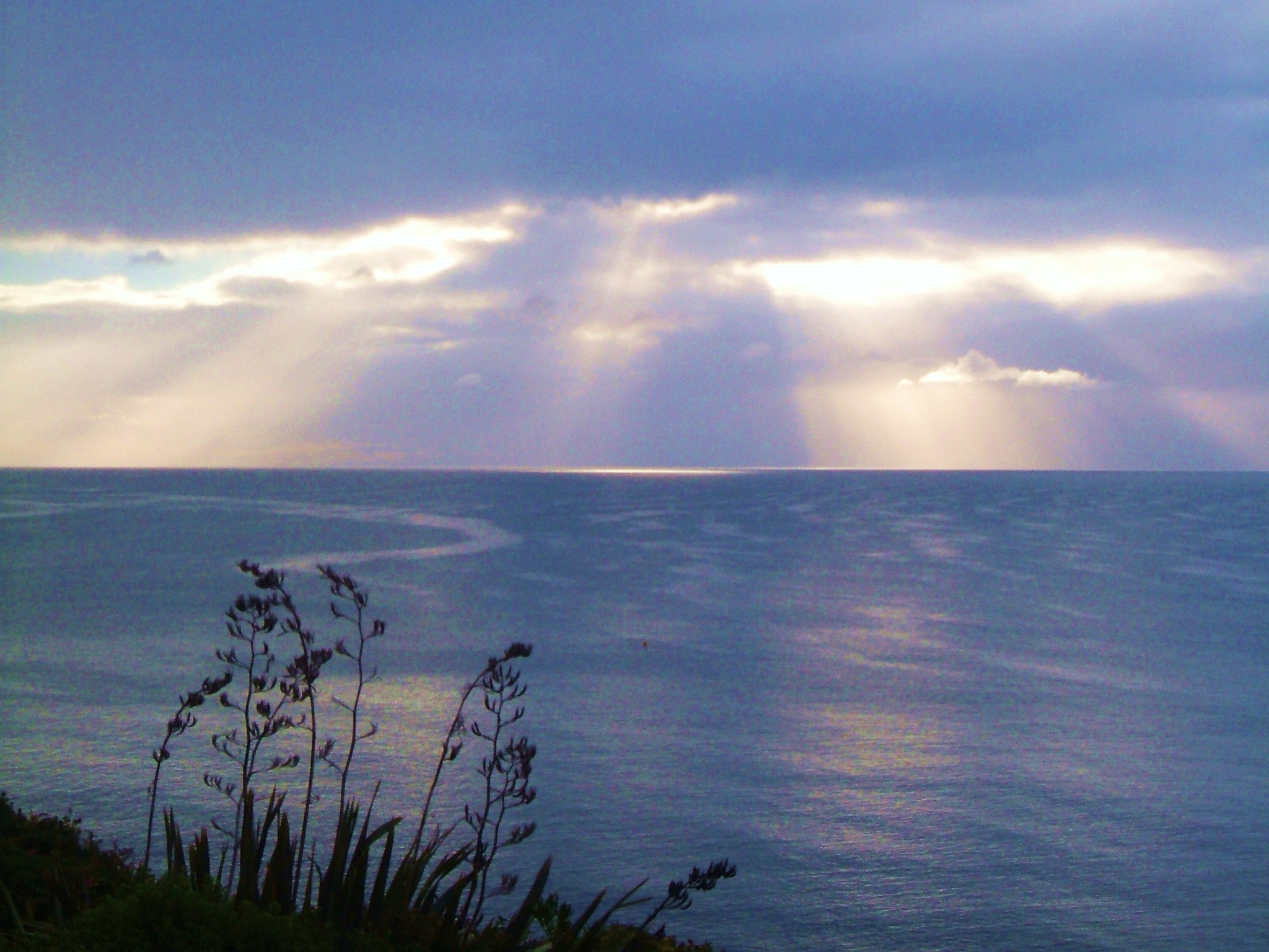 Sun rays breaking through the clouds by Sandra Wright