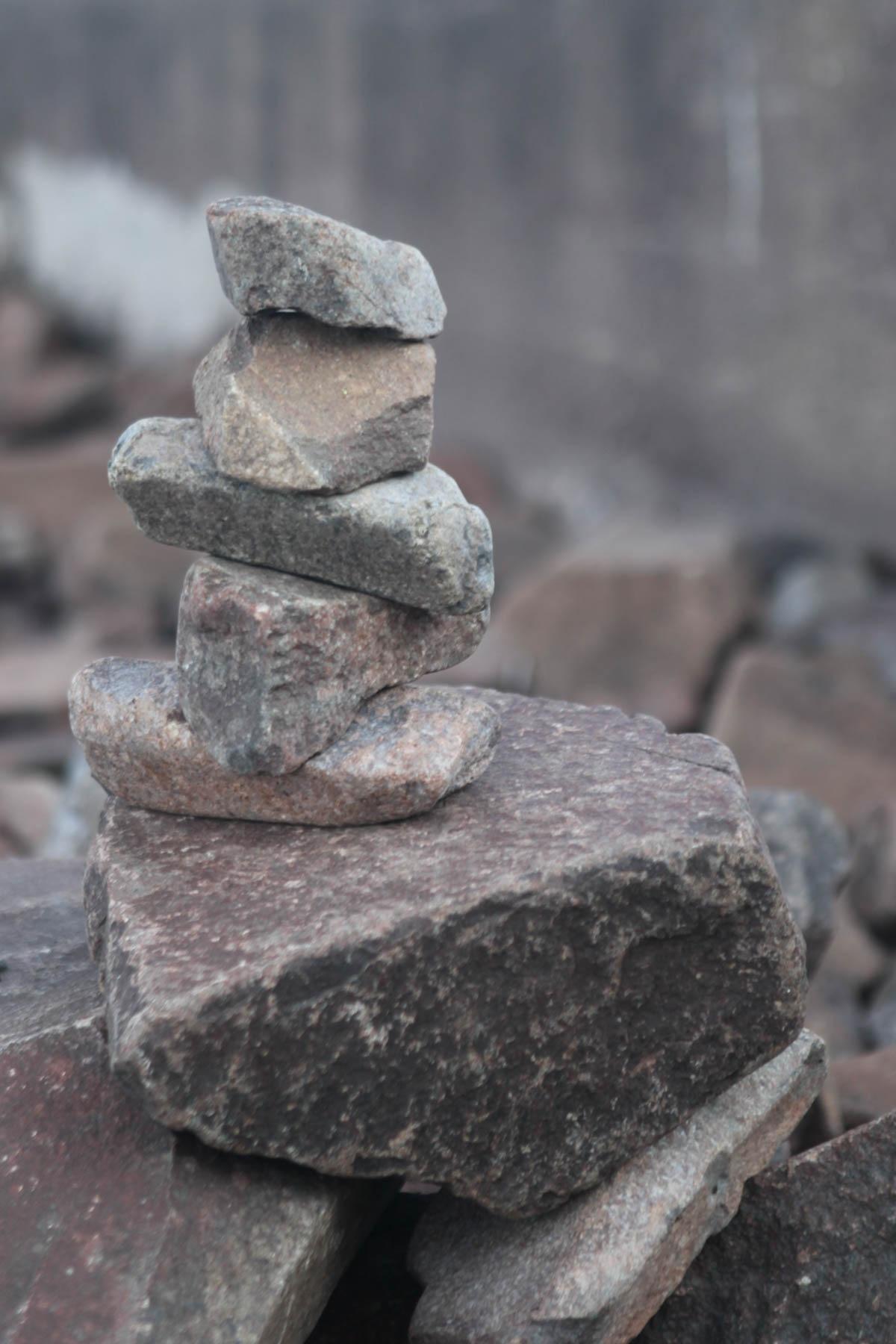 rocks on beach grand marais mn by Bernard Mordorski
