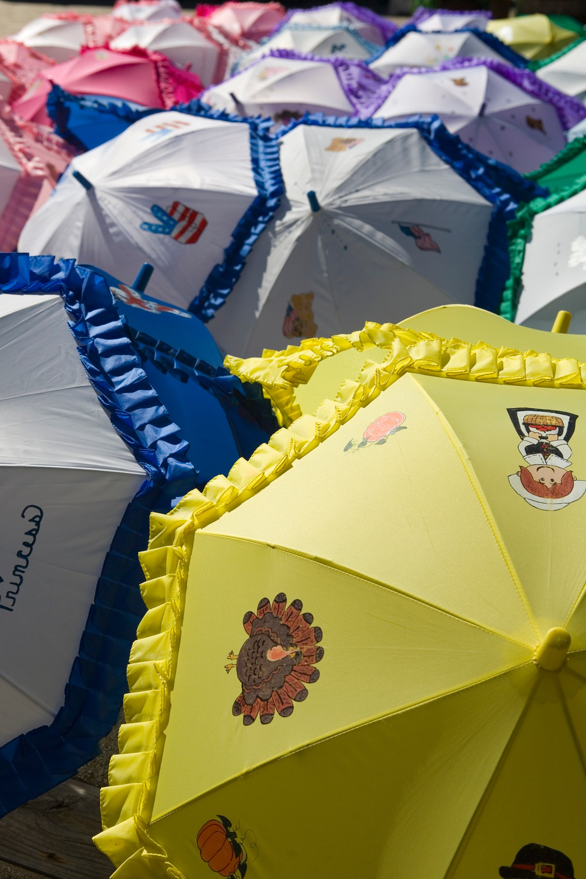 many umbrellas of many colors by Bernard Mordorski