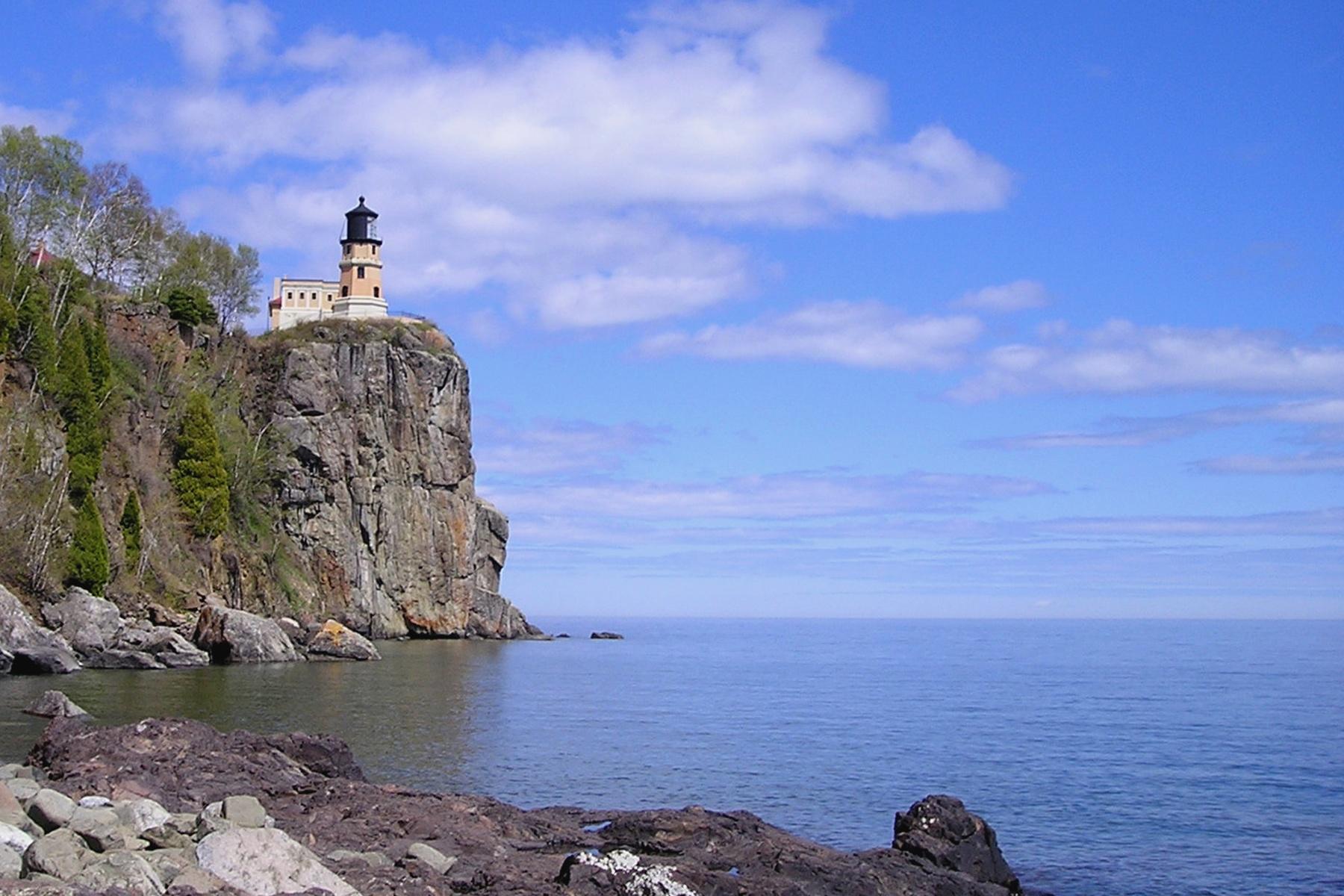 Splt Rock Lighthouse from the shore in spring by Bernard Mordorski