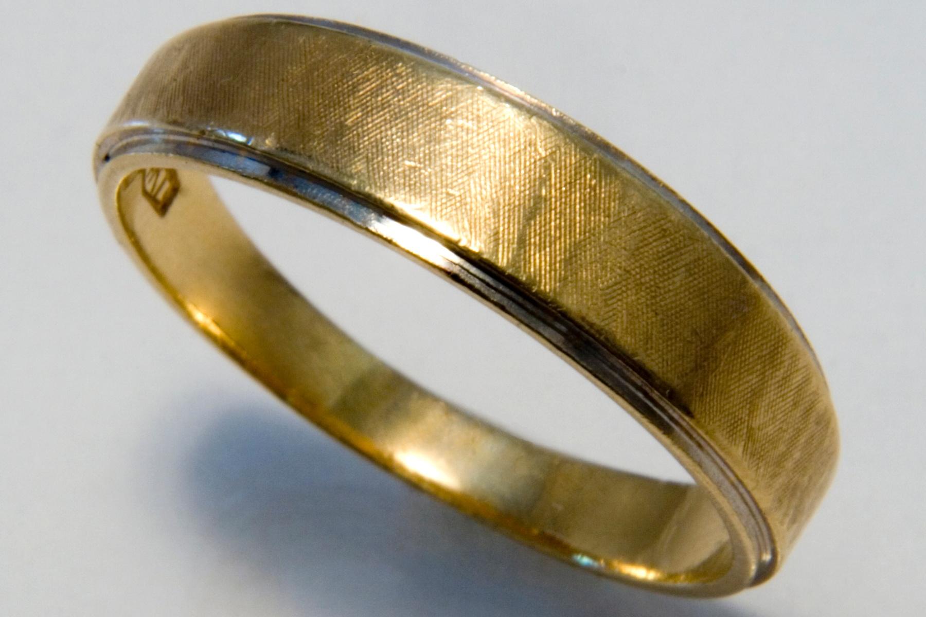 male wedding ring close up by Bernard Mordorski