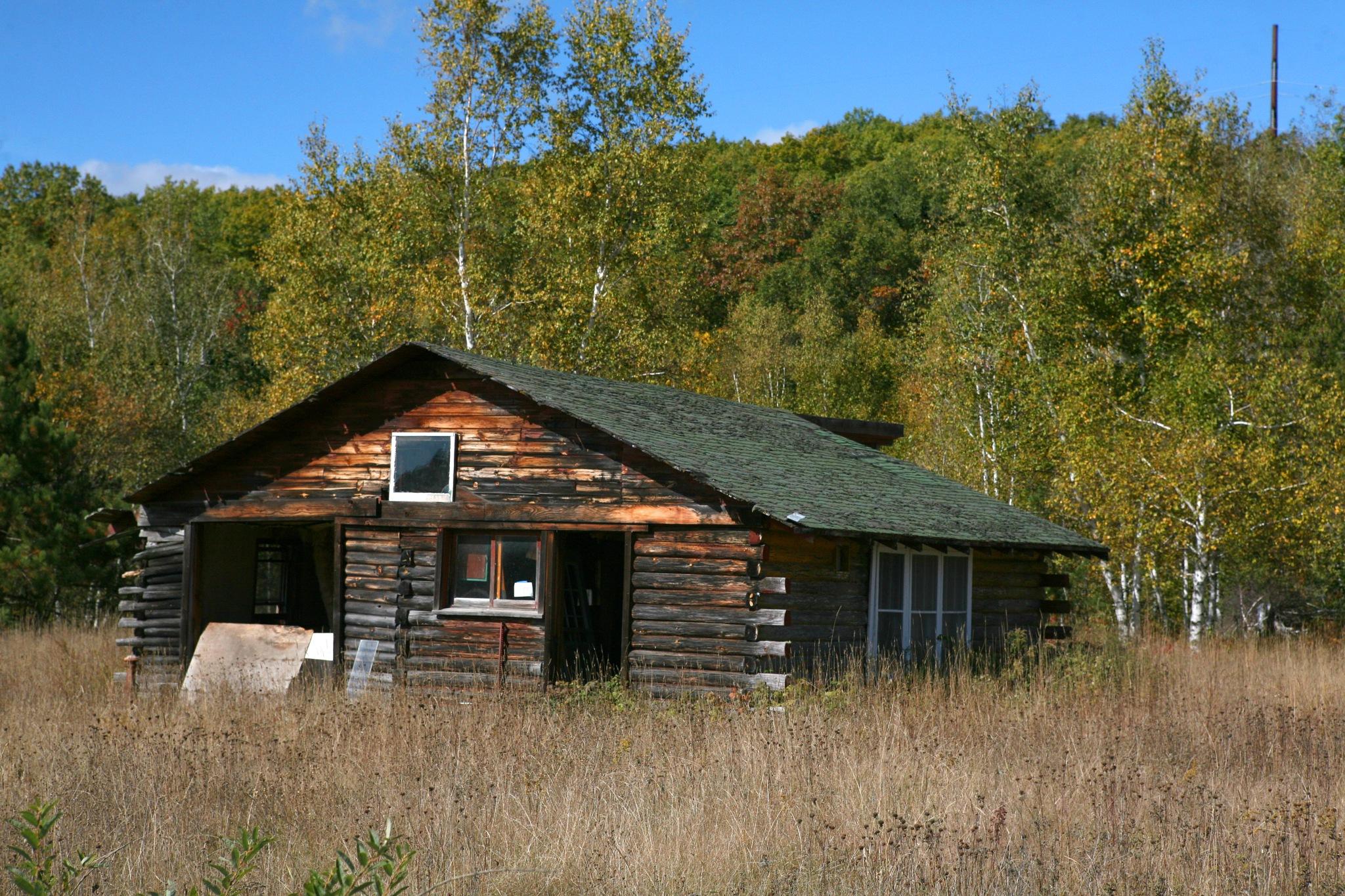 deserted cabin in the north woods by Bernard Mordorski