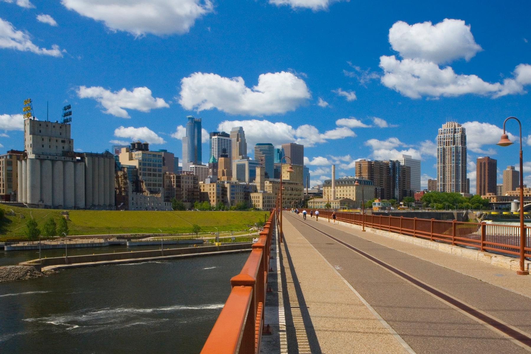 Minneapolis MN skyline from Stone Arch Bridge by Bernard Mordorski