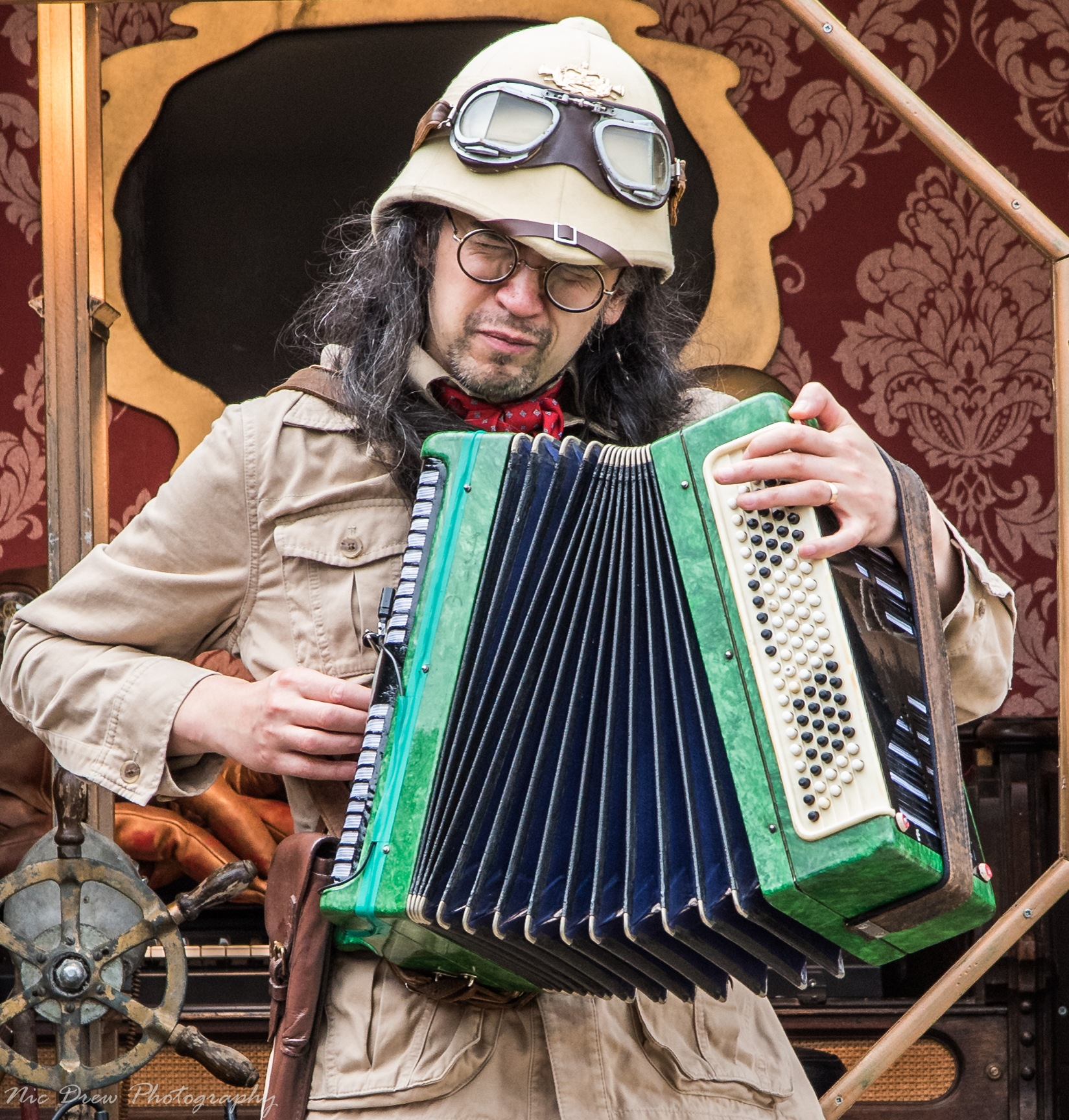 The squeeze box player by Nic Drew
