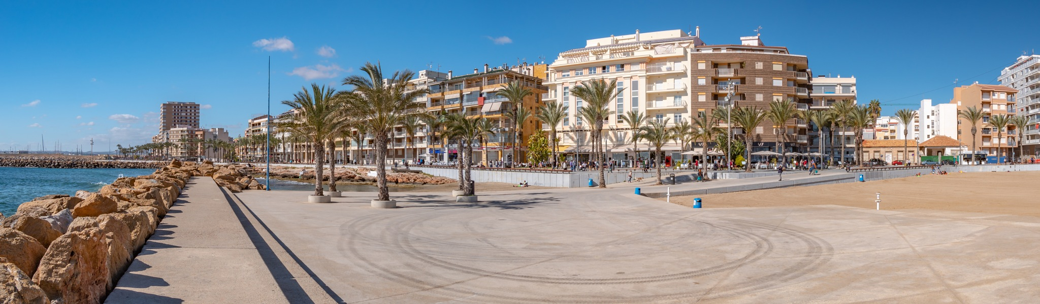 Photo in Sea and Sand #torrevieja #costa blanca south #sea #rocks #seafront #walkways #promenade #palm trees #blue sky