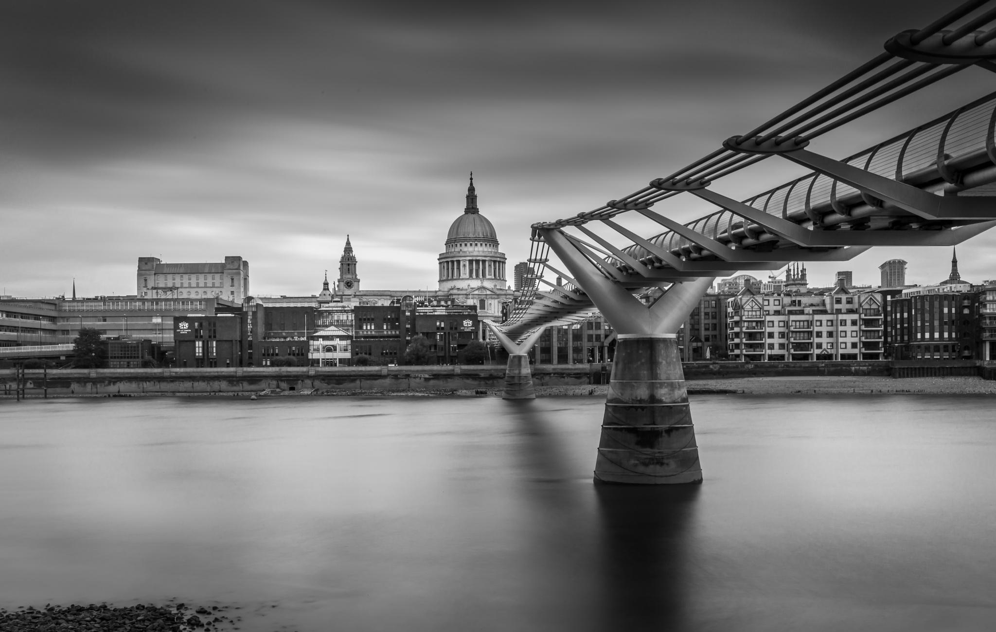 Bridge over still water by Chris Lee