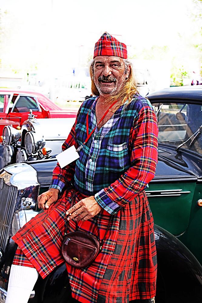 Photo in Street Photography #street #people #street people #street portrait #scottish #man #male #man portrait #bizarre #odd #life #live #stranger #danger #vintage #vintage car #outdoor #expression #smoker