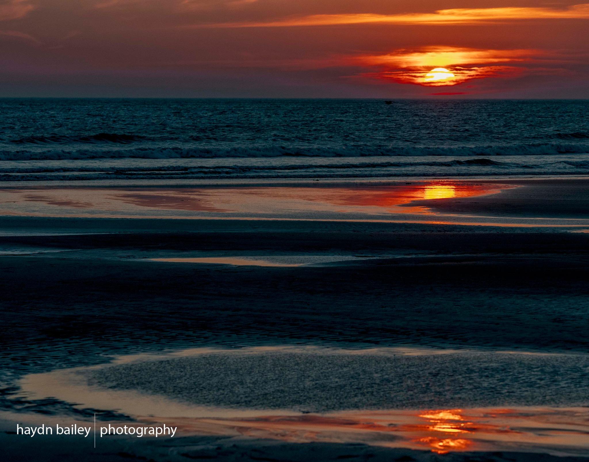 Setting sun in Wales by Haydn Bailey