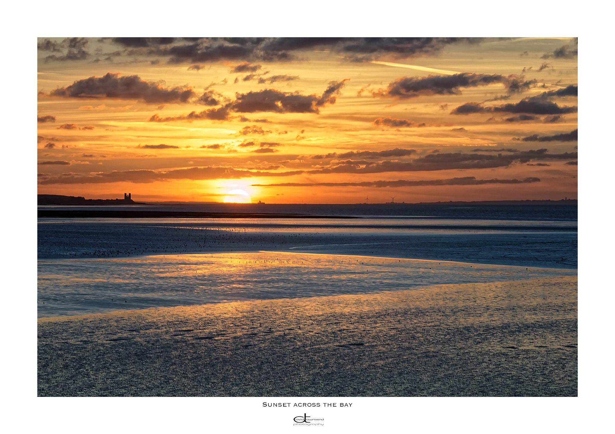 Sunset across the bay  by David Townsend