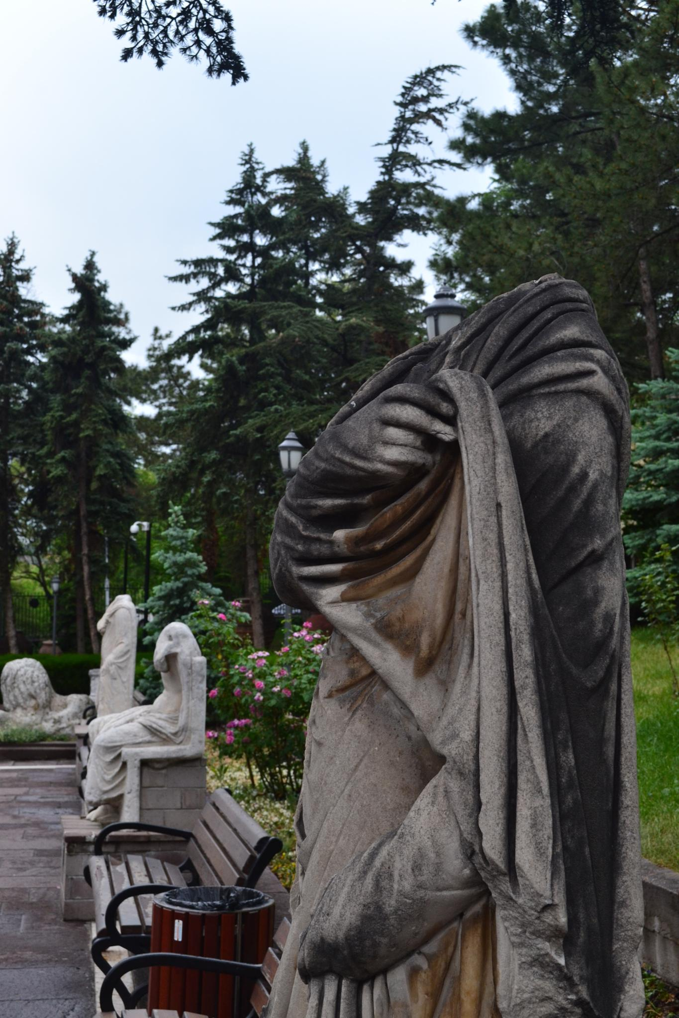 statue in the garden by mervetuna