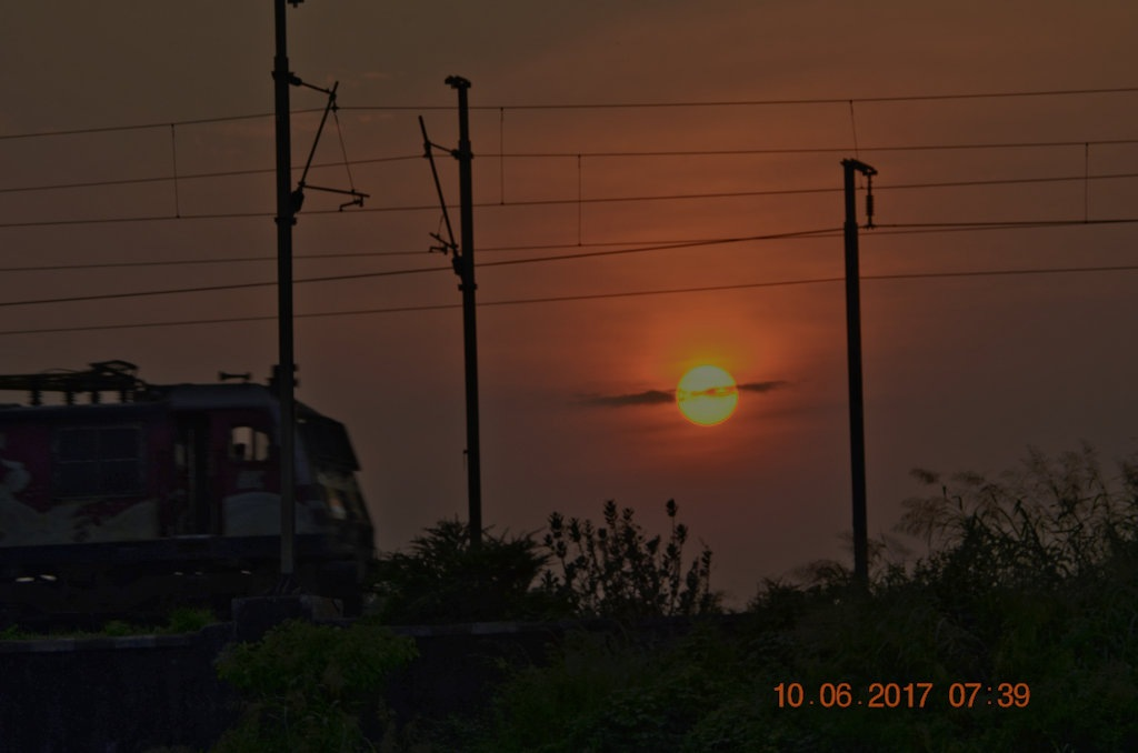 The Sunset behind the railway track by Sunil