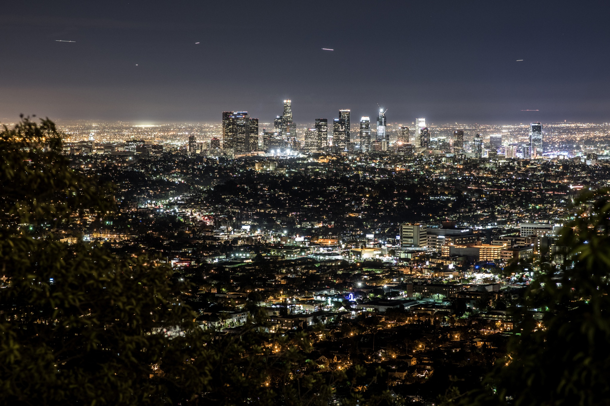 LA Cityline With Plane Streams by James Kang