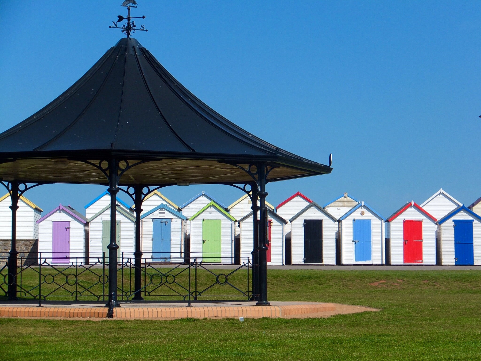 Beach huts and bandstand by Kim Howes