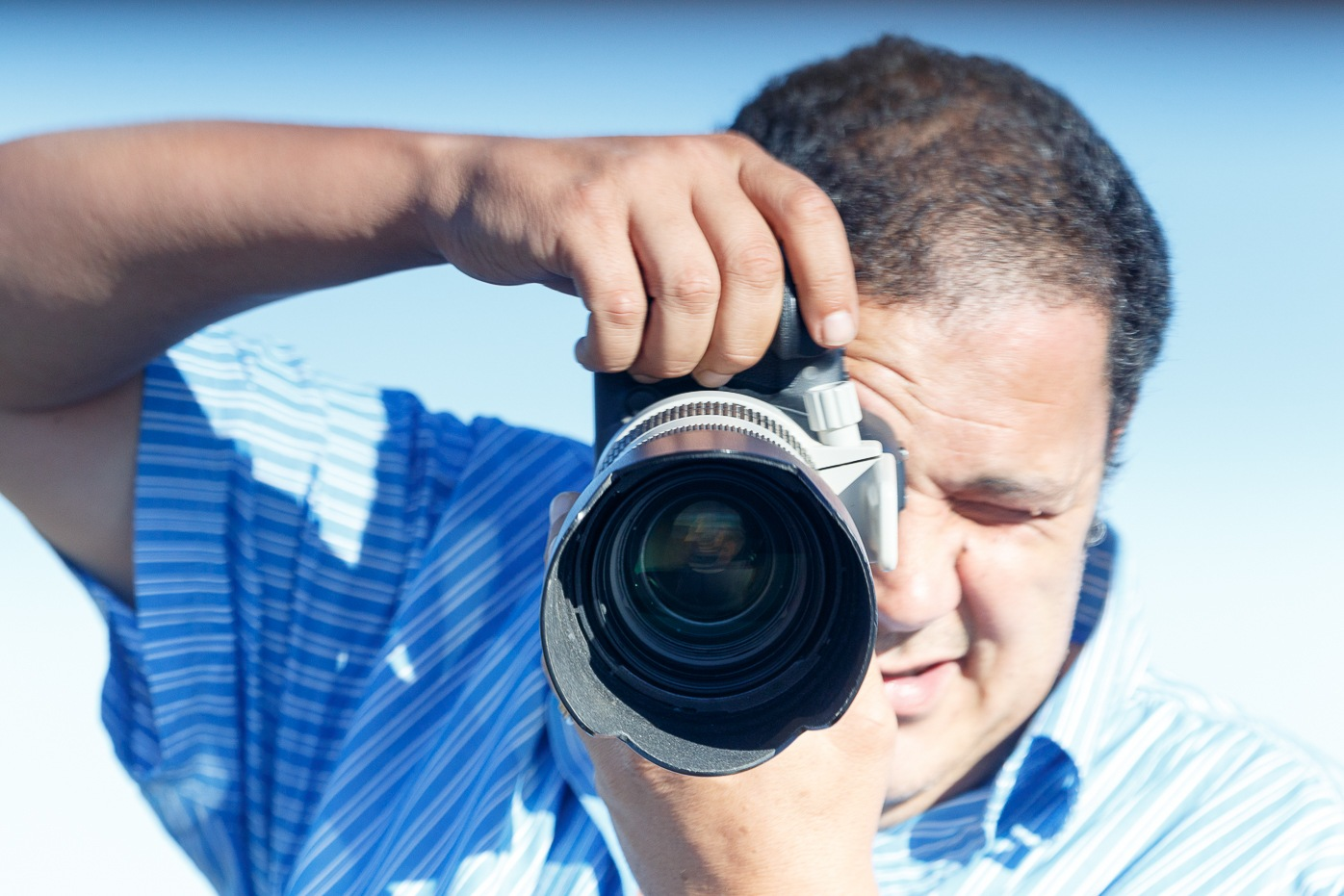 Man standing with his camera ready for action by Charissa de Scande Lotter