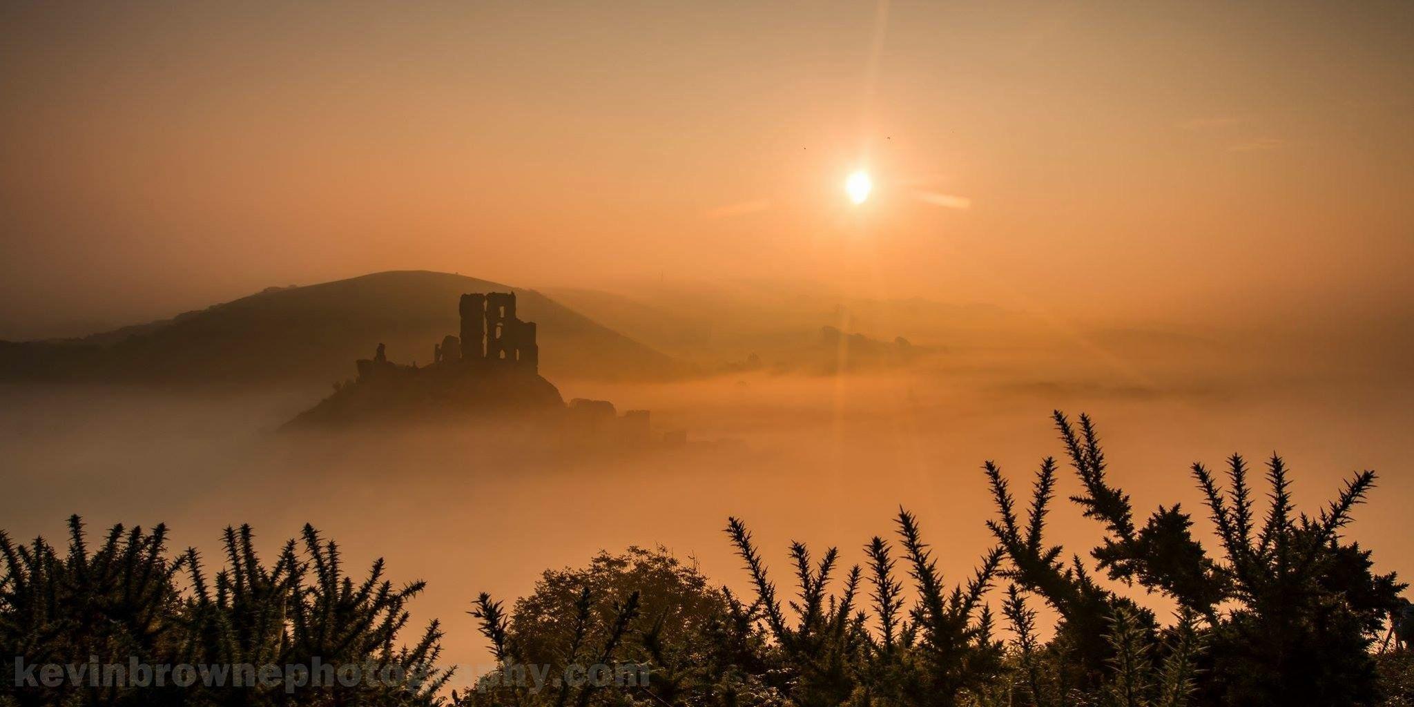 Misty Sunrise at Corfe Castle by KevinBrownePhotography