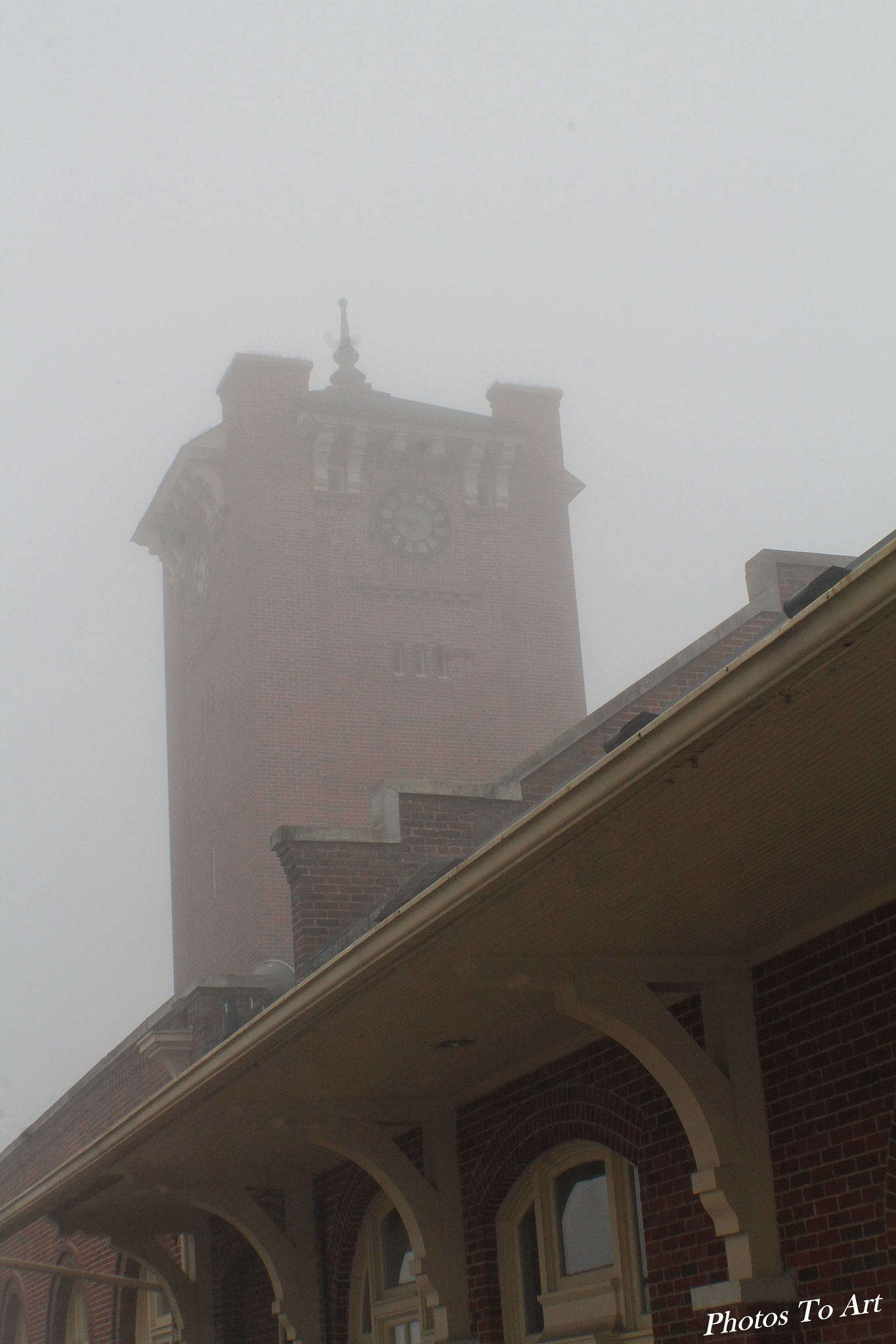 foggy train station by Calvin Burdette