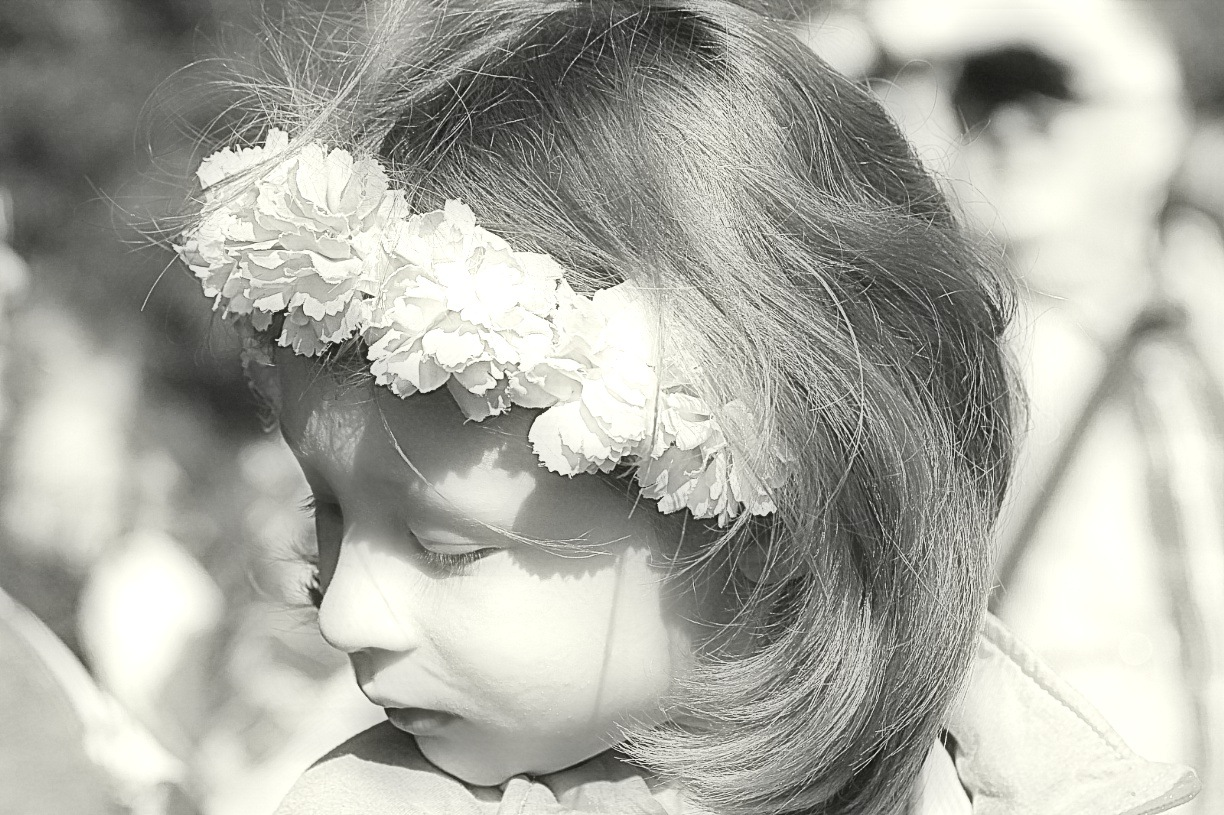 Girl with flowers in her hair in black and white by Rob Helliker