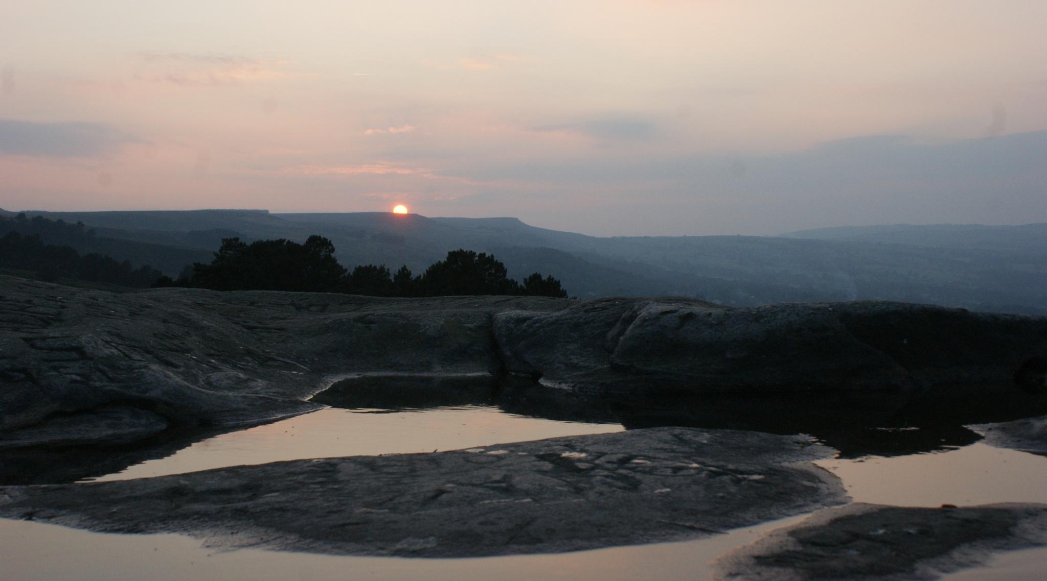 puddle sunset by martynroydawson
