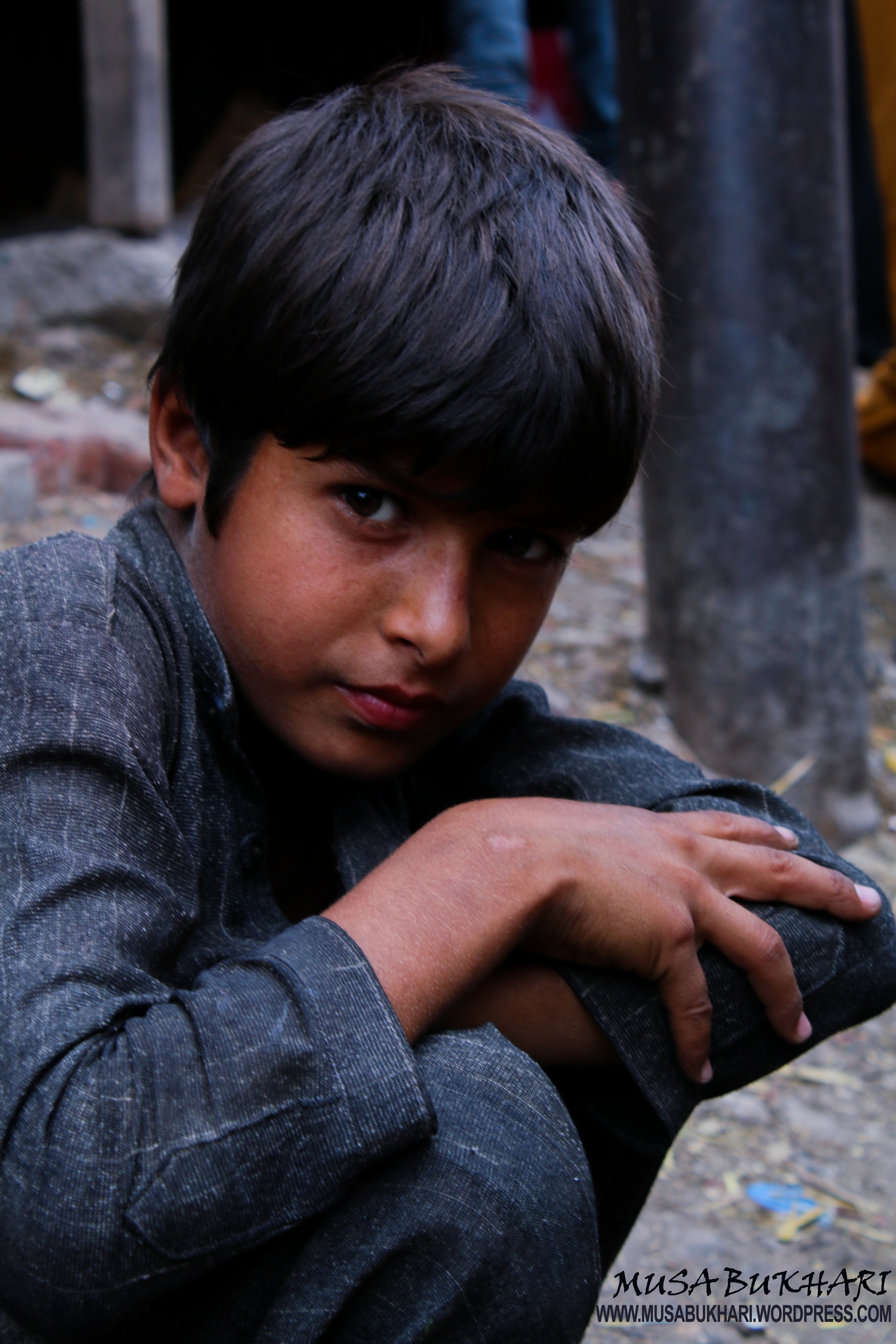 Photo in Street Photography #child. #labour.lahore.working.poor. #rights.smile.