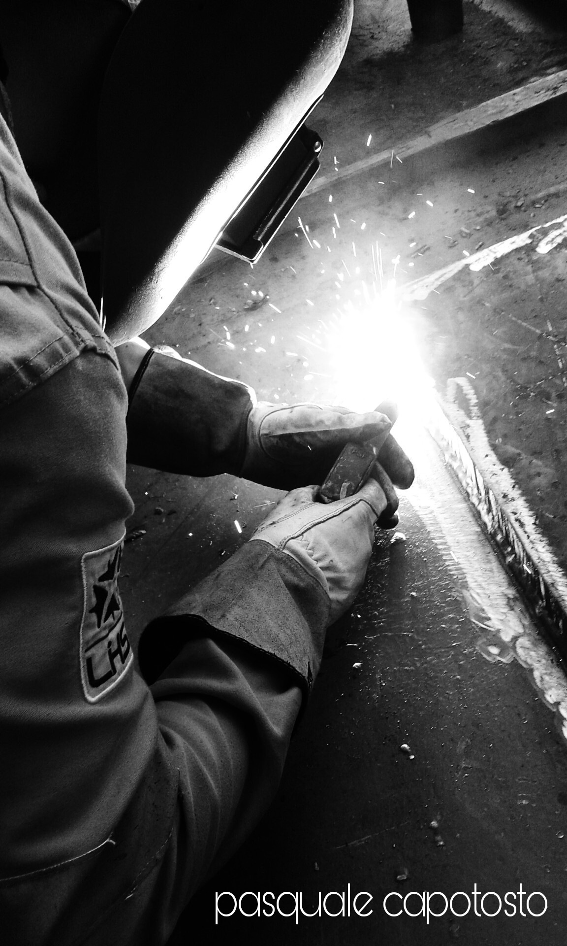 welder by Pasquale Capotosto