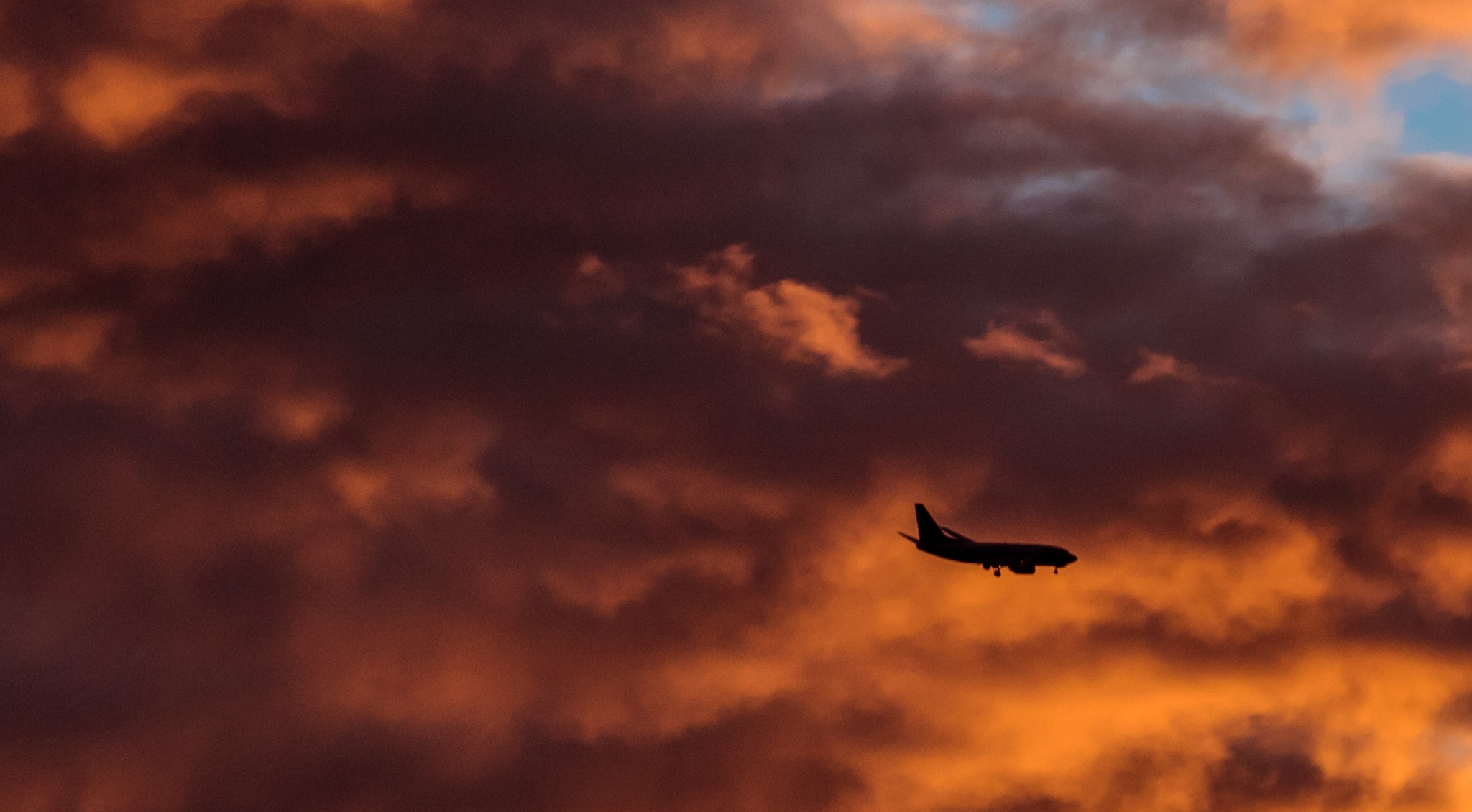 Airplane in fire clouds by Roger Indgul