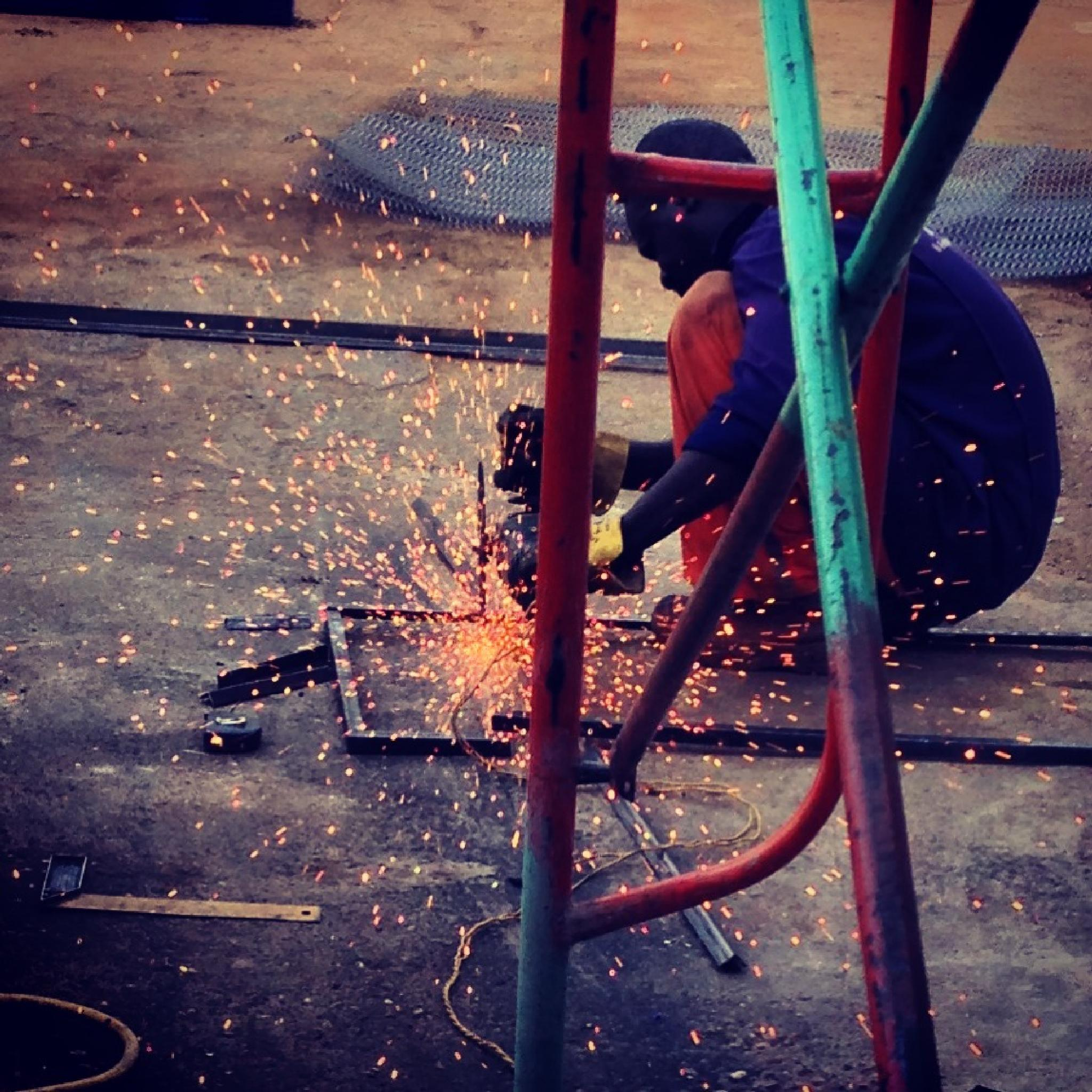 Sudan worker working hard by Blacky Li