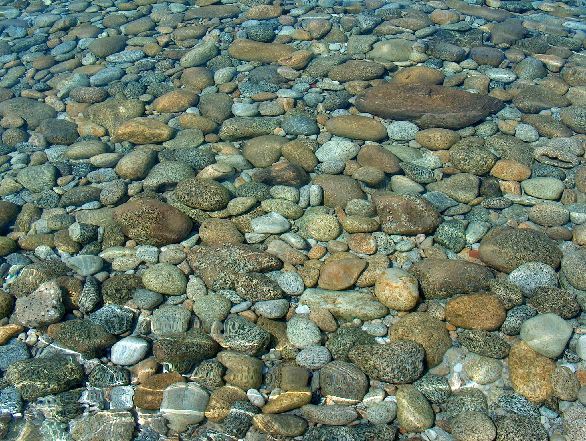 crystal water and a carpet of peebles by Carlo Orsettigh