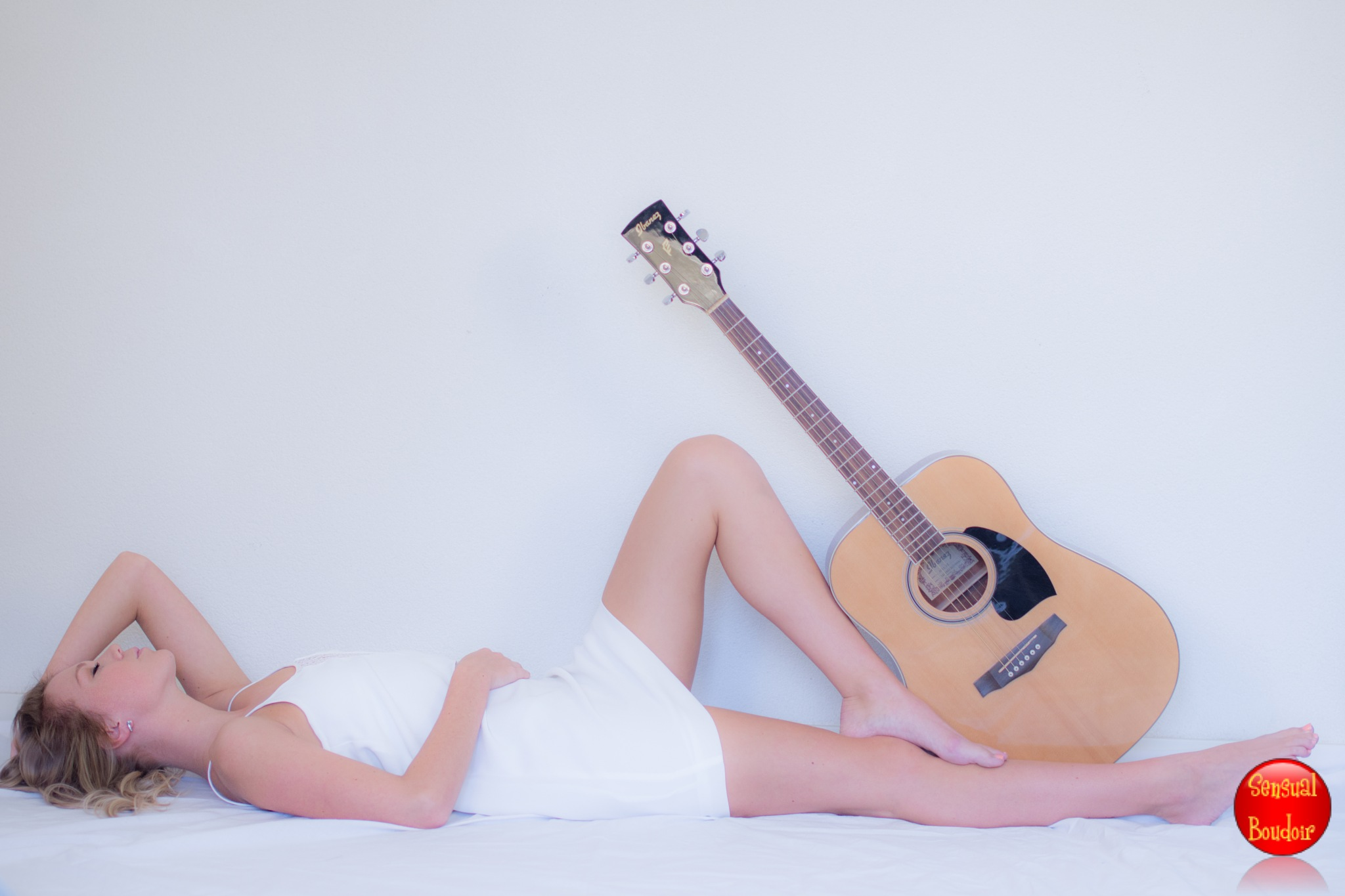 Sexy with a guitar by Sensual and Boudoir