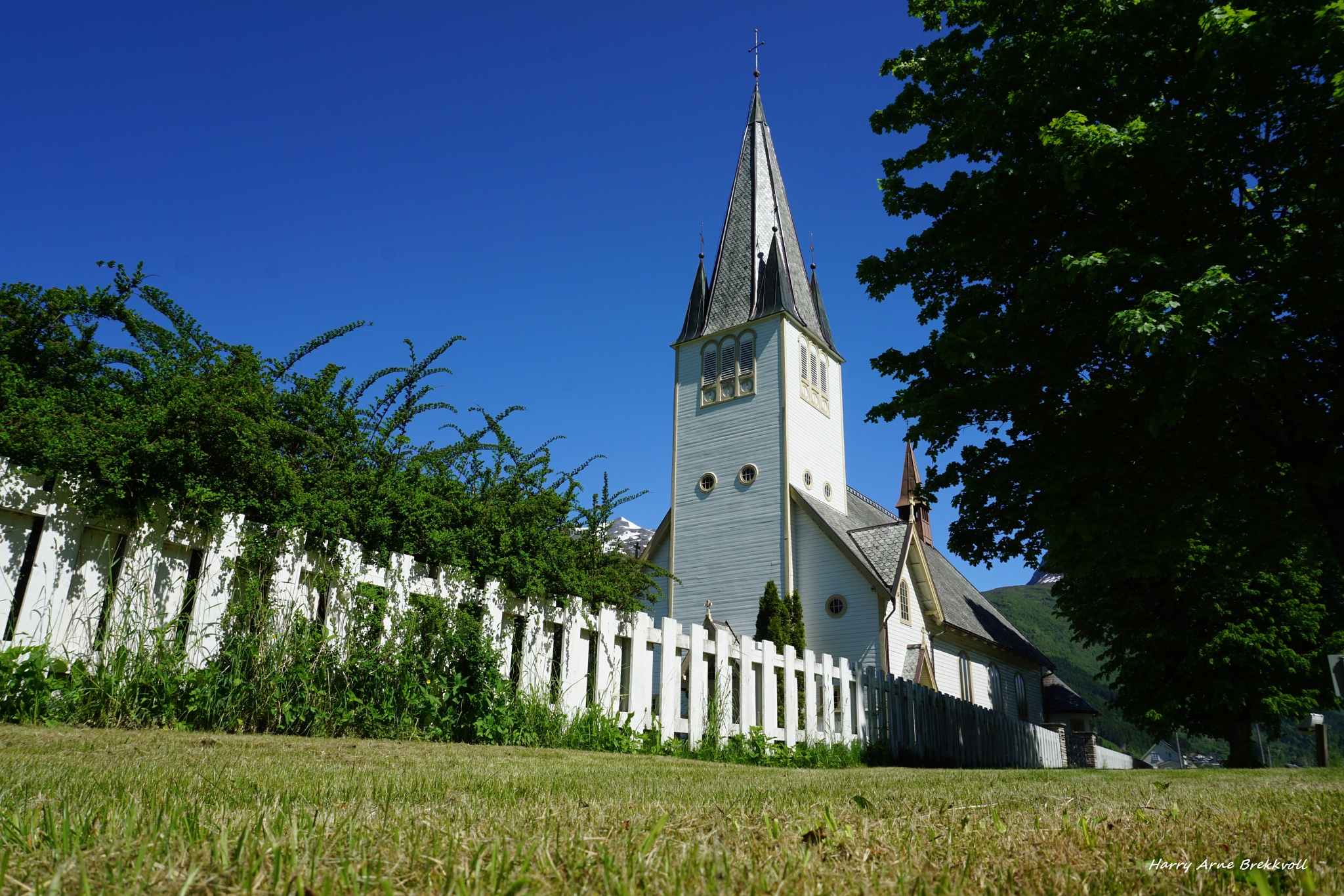 Photo in Architecture #church #white #green #norway #trees #sky