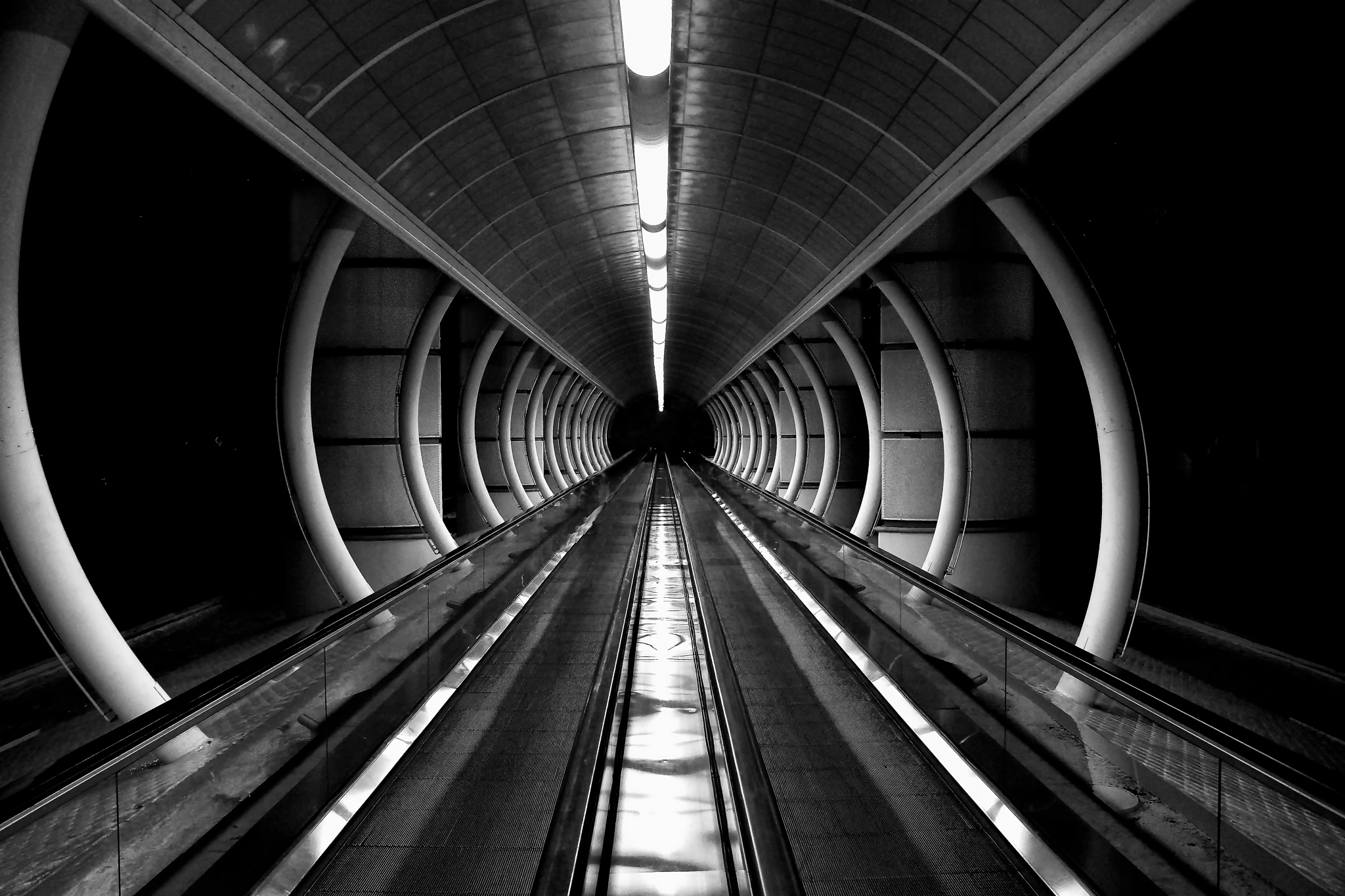 Photo in Abstract #tunneling #las #vegas #moving #sidewalk #black #and #white #abstract