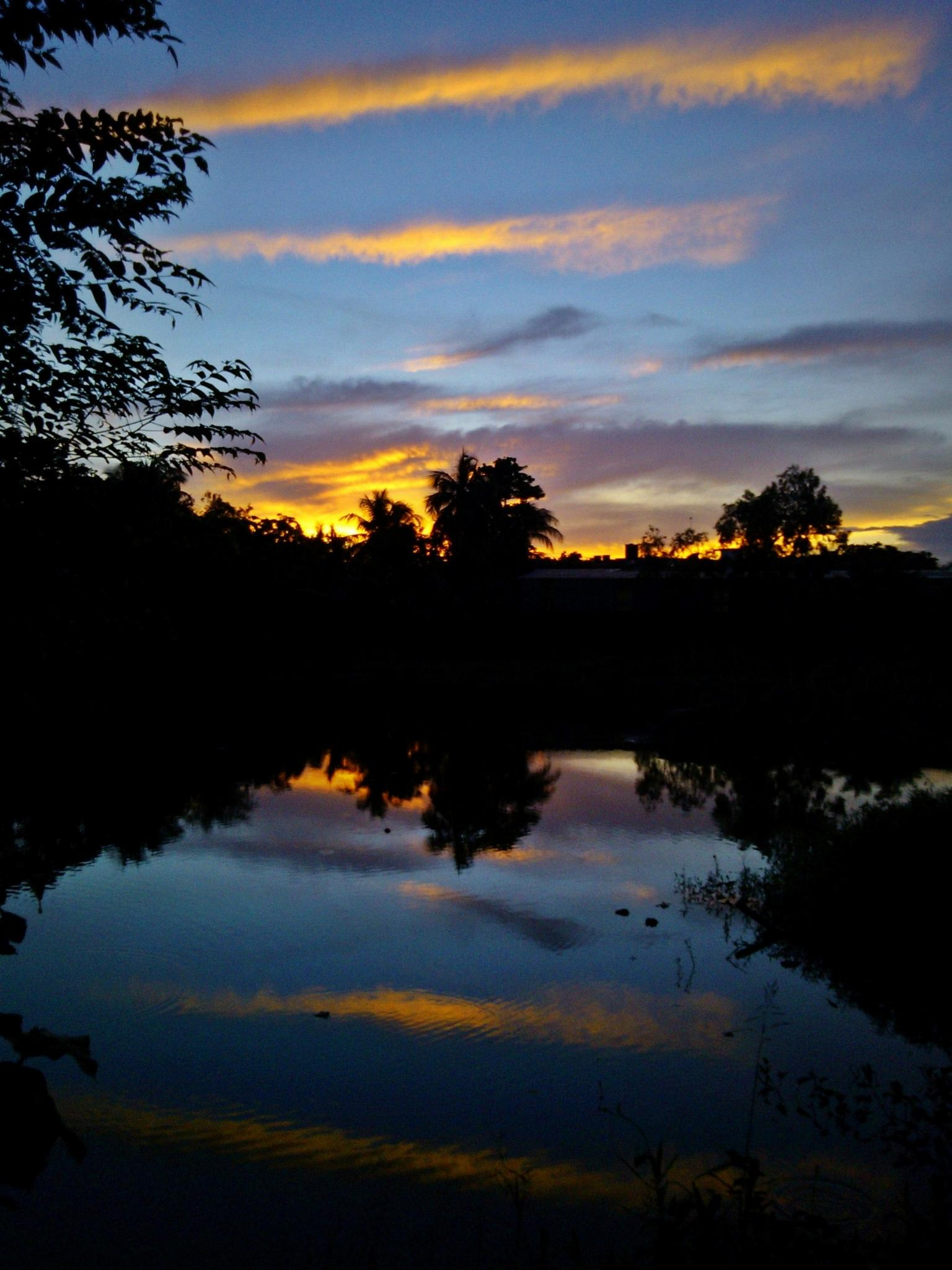 Reflection of sunset by Abhishek Sarkar