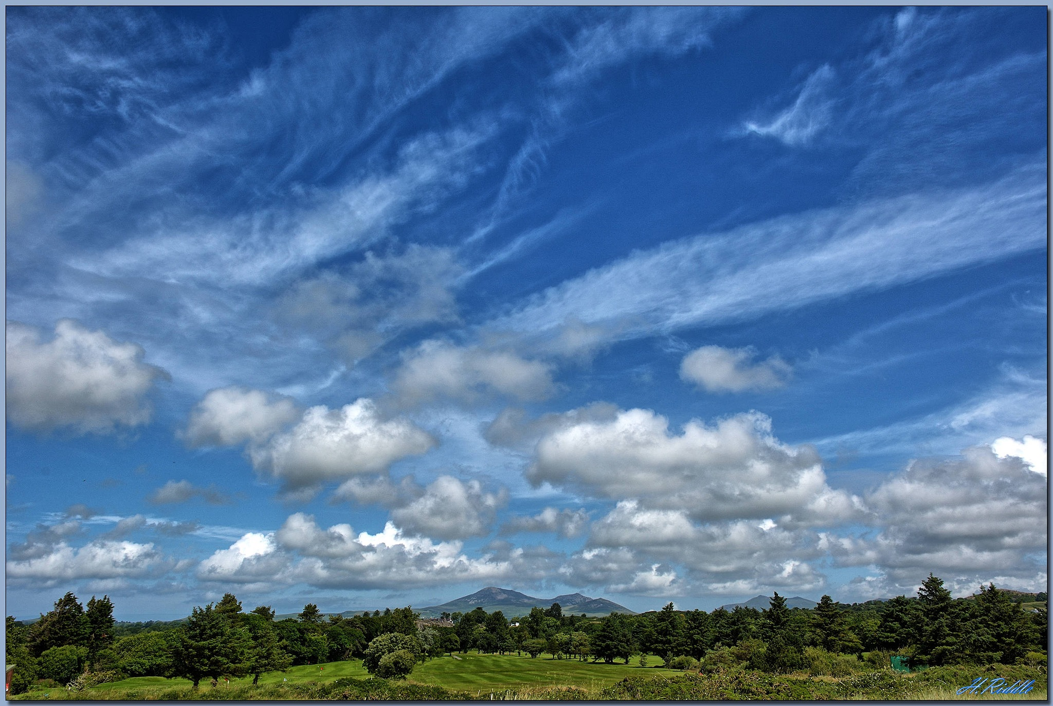 Big skies towards Snowdonia by Herb Riddle