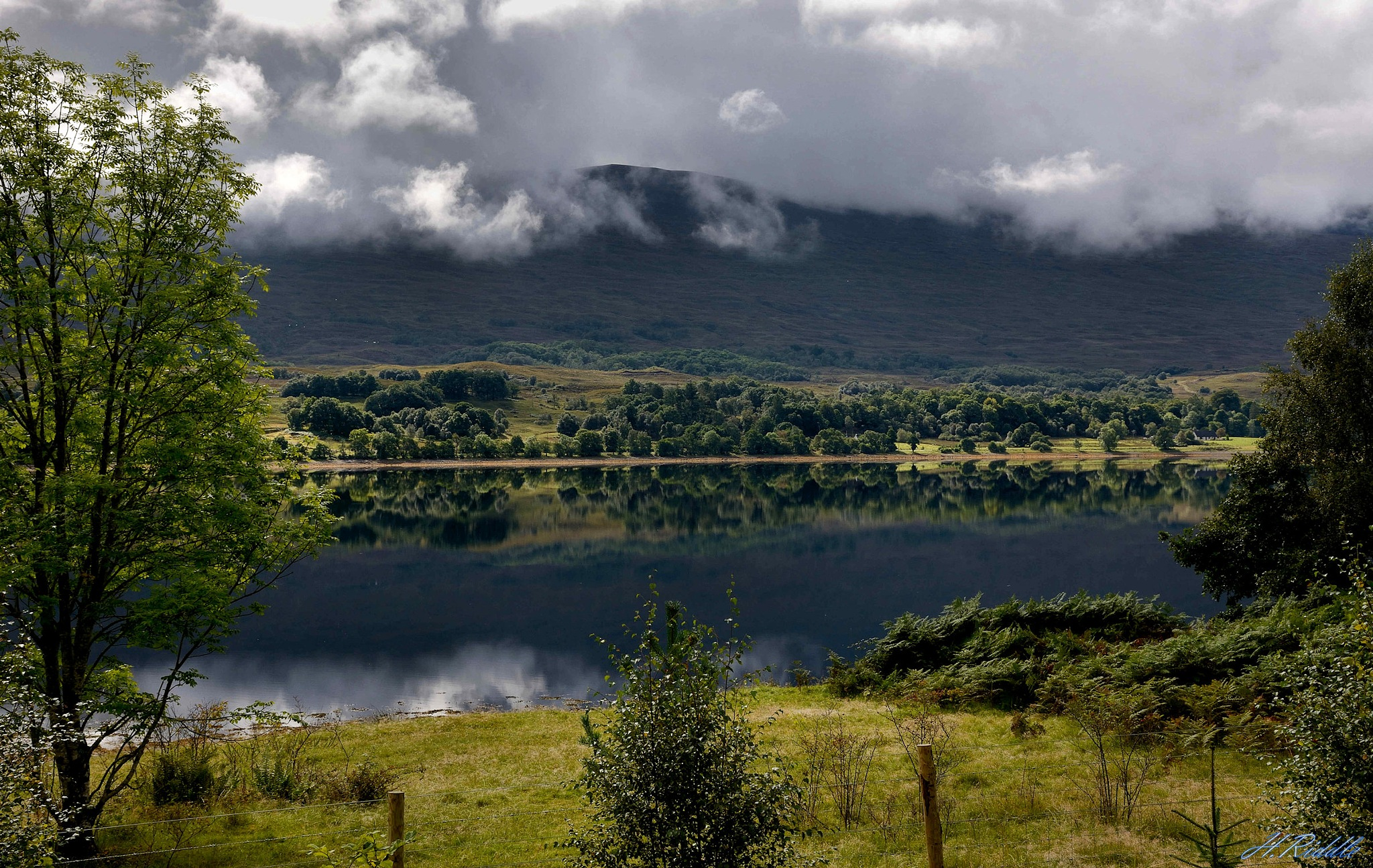 Highland reflections by Herb Riddle