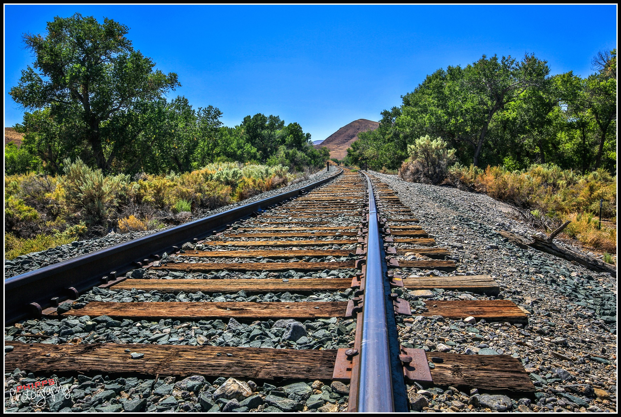 Rails Heading West... by PhippsPhotography