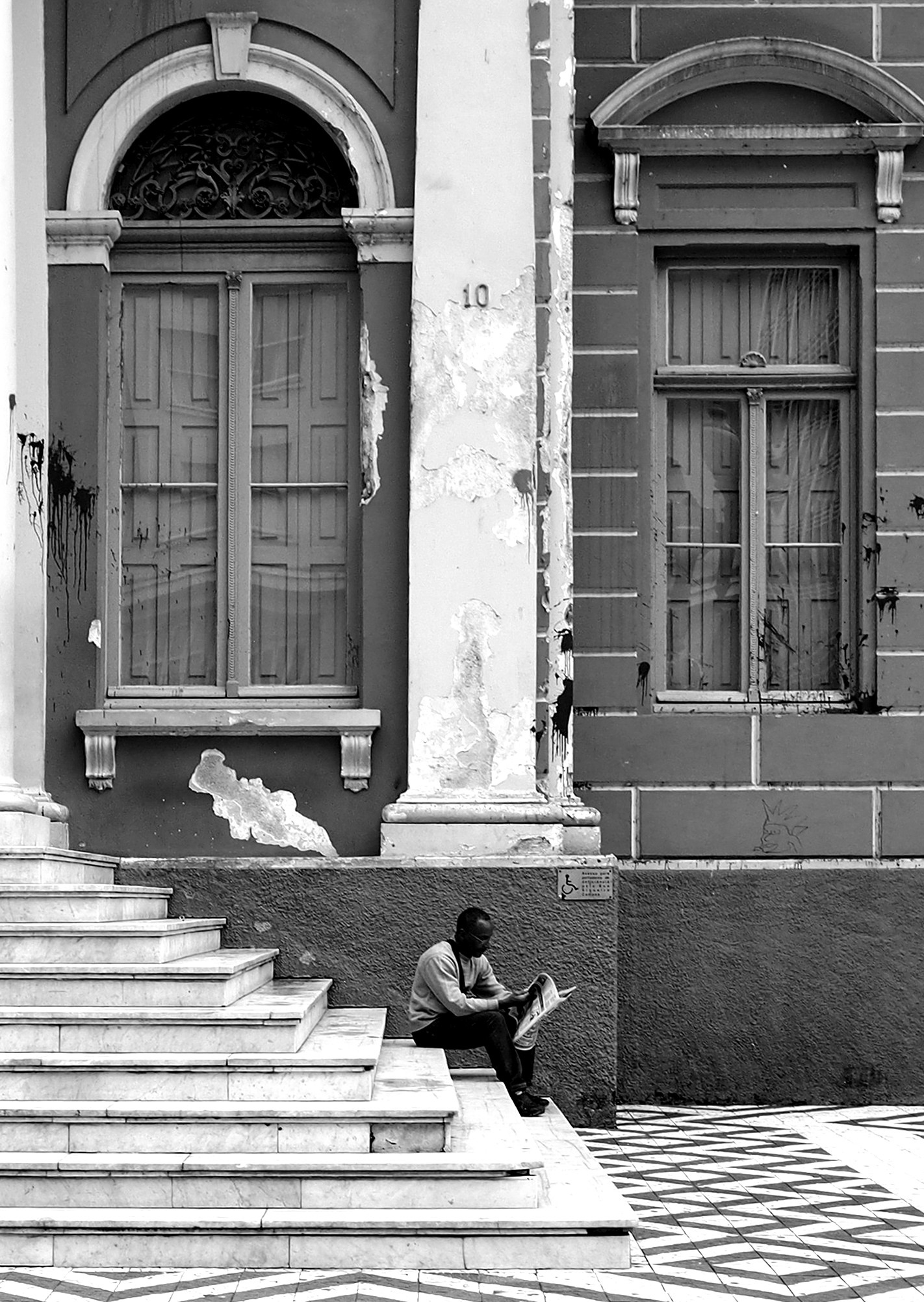 Steps in front of Porto Alegre, Brazil, city hall: a place for a quiet reading, a place for protest. by Rocco Footography