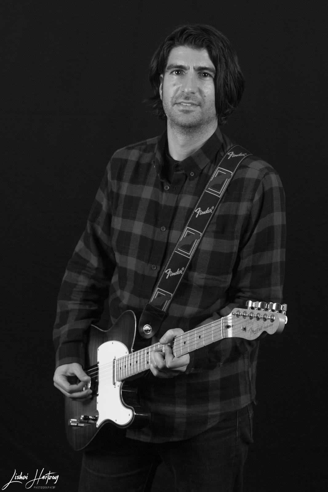 The guitarist by Lishai Herzog
