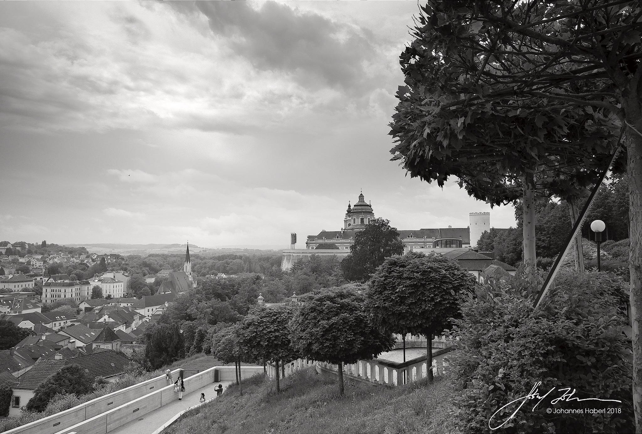 beautiful Abbey Melk with surrounding city and landscape / B&W by Johannes Haberl