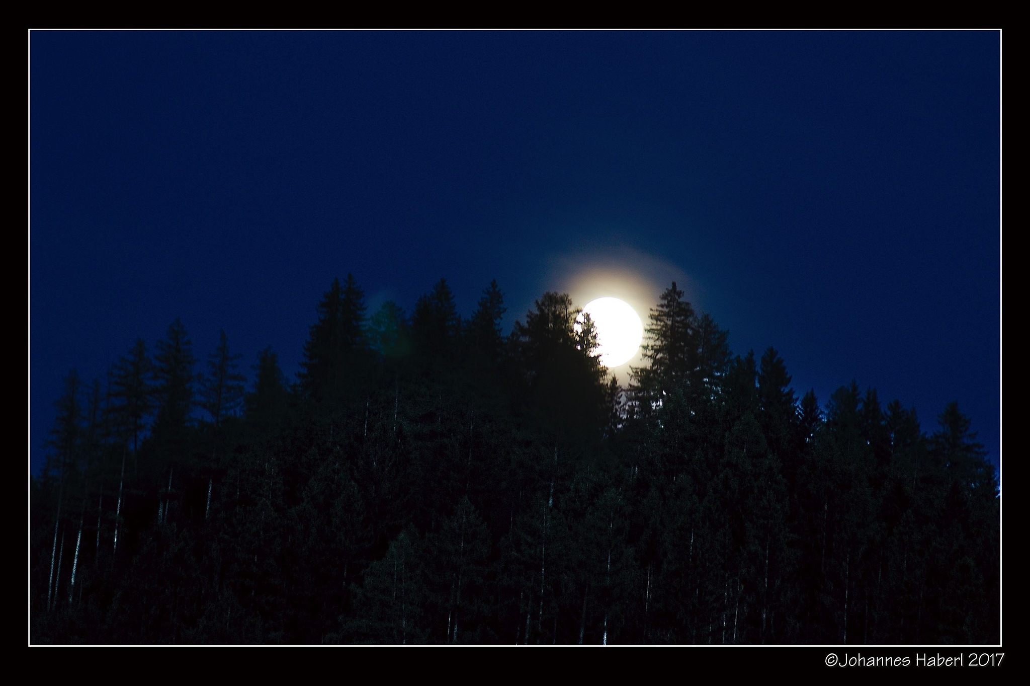 full moon rising by Johannes Haberl