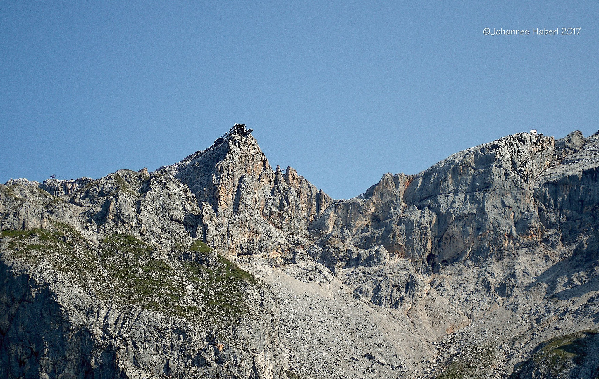 view to the top station of Dachstein cable railway / detail by Johannes Haberl