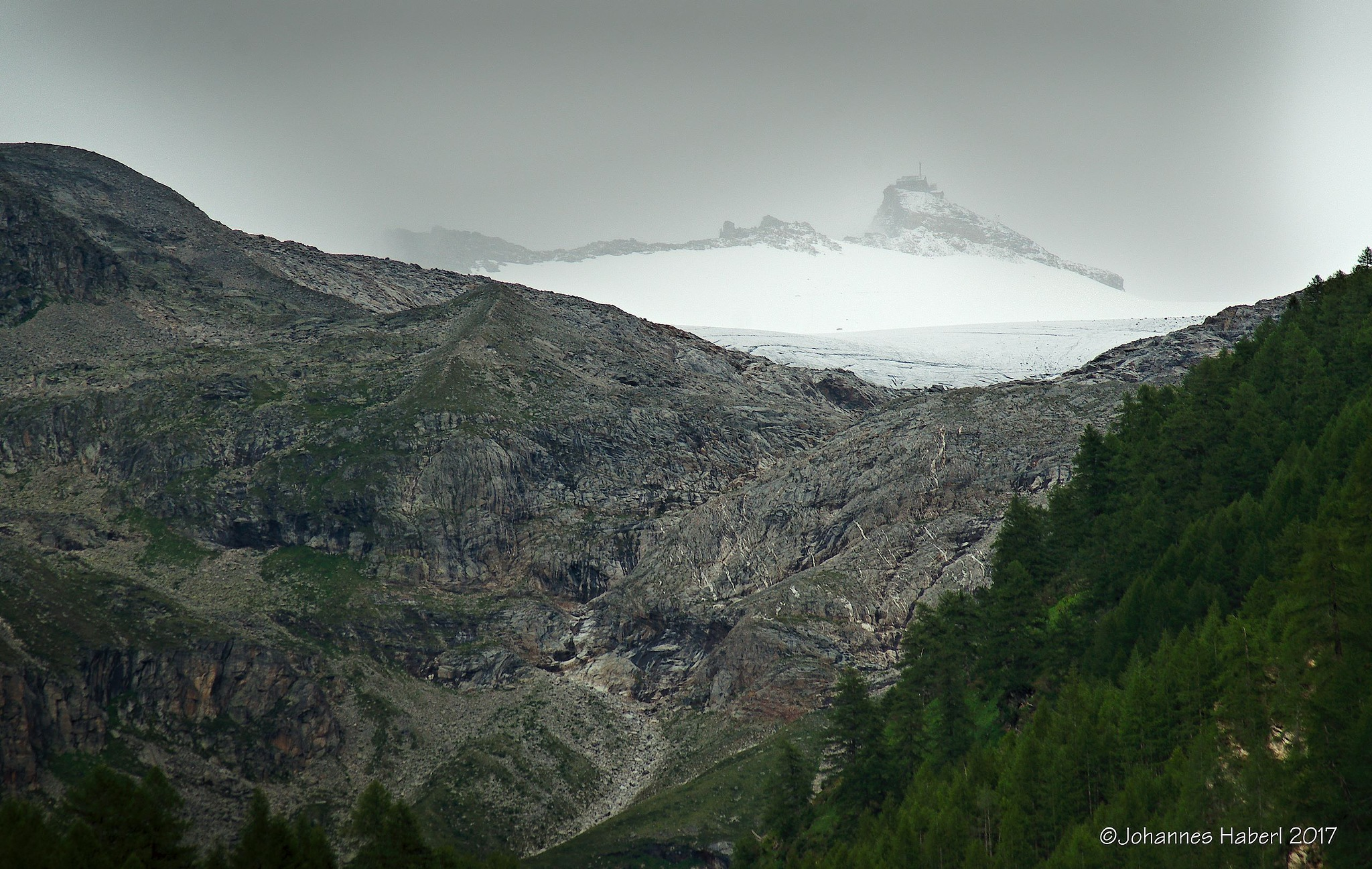 view up to the snow ... with alpine architecture also on the top  by Johannes Haberl