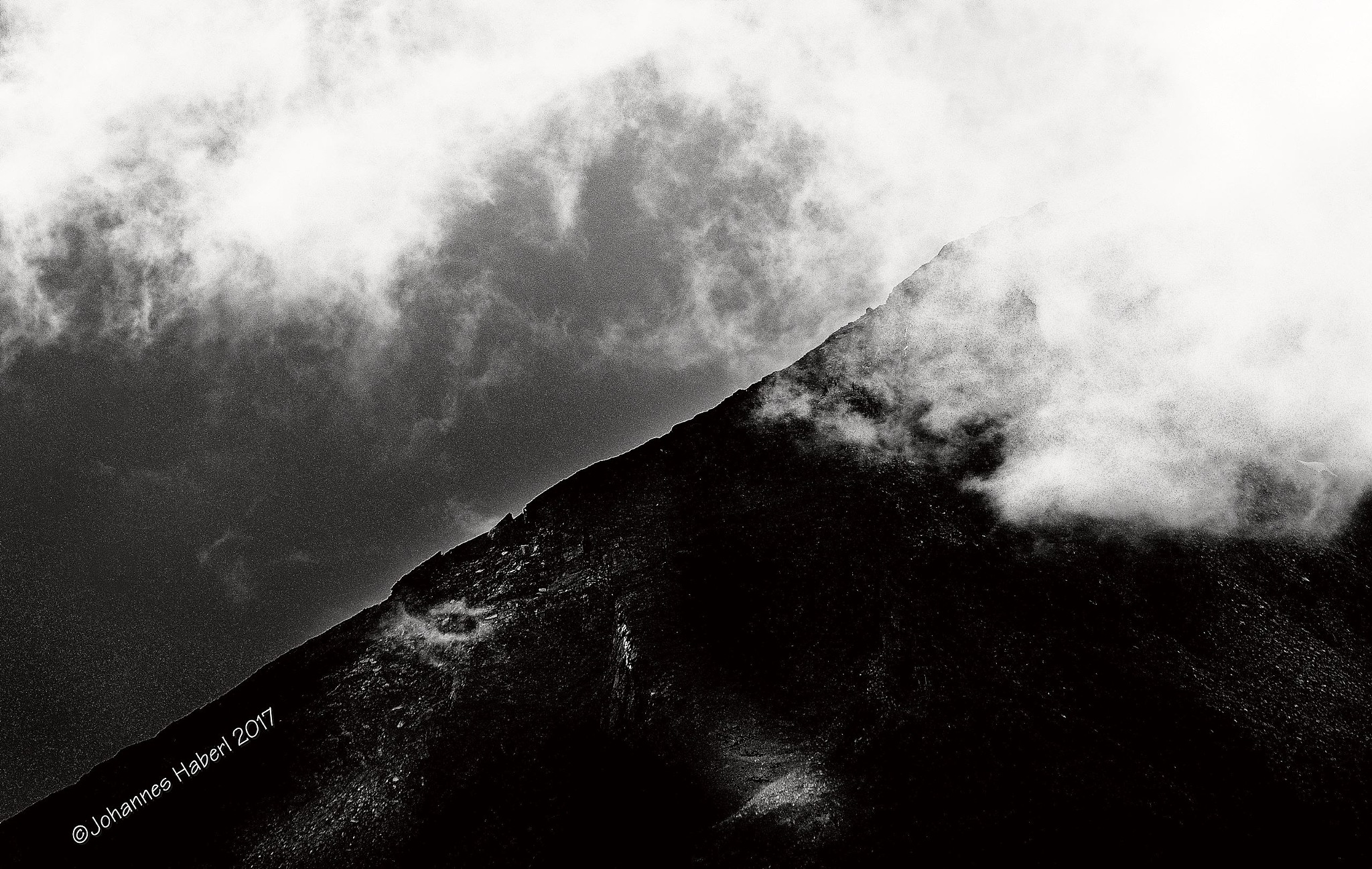 clouds over the top II / B&W  by Johannes Haberl