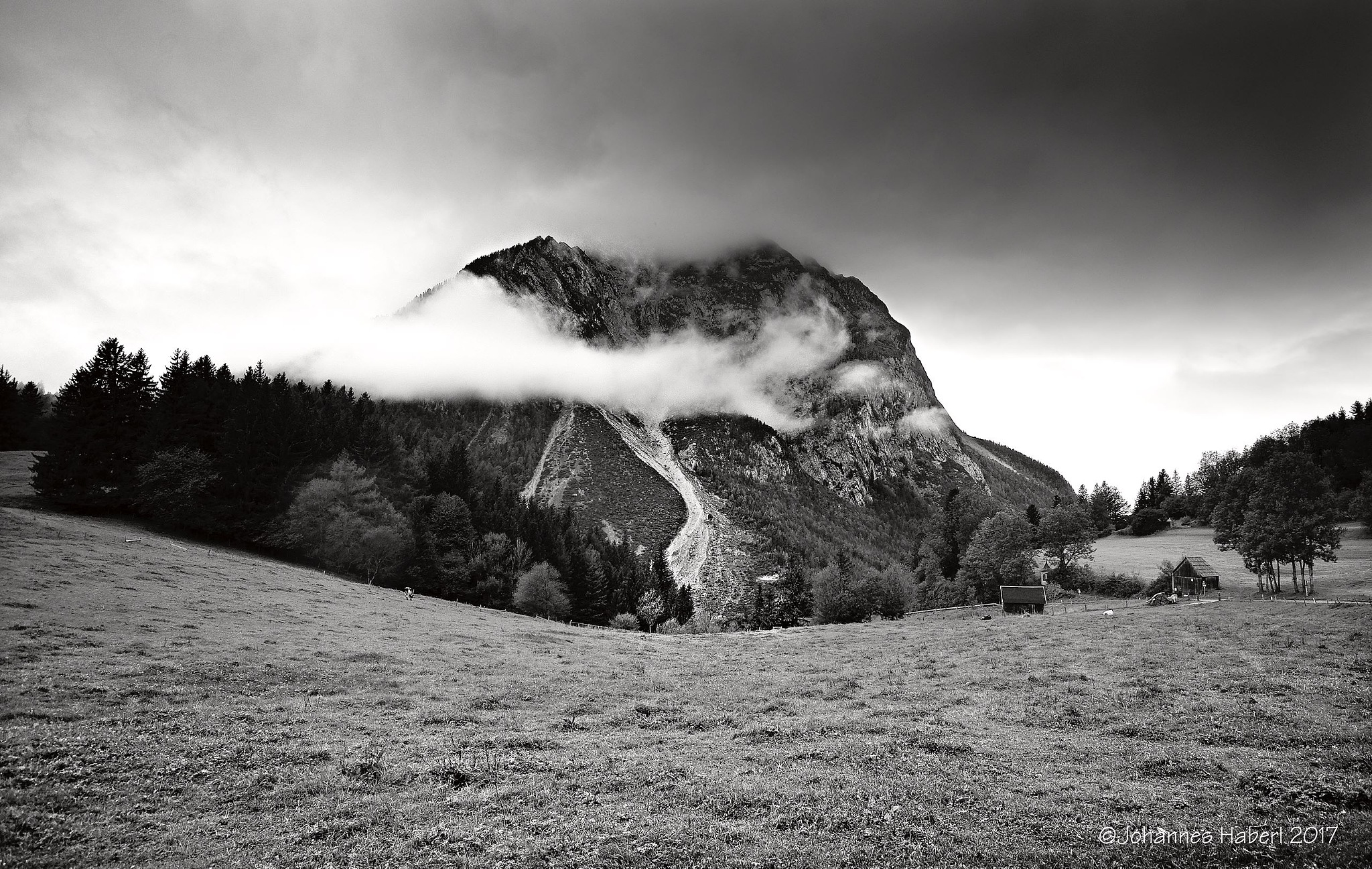 mountain Grimming with clouds / B&W by Johannes Haberl