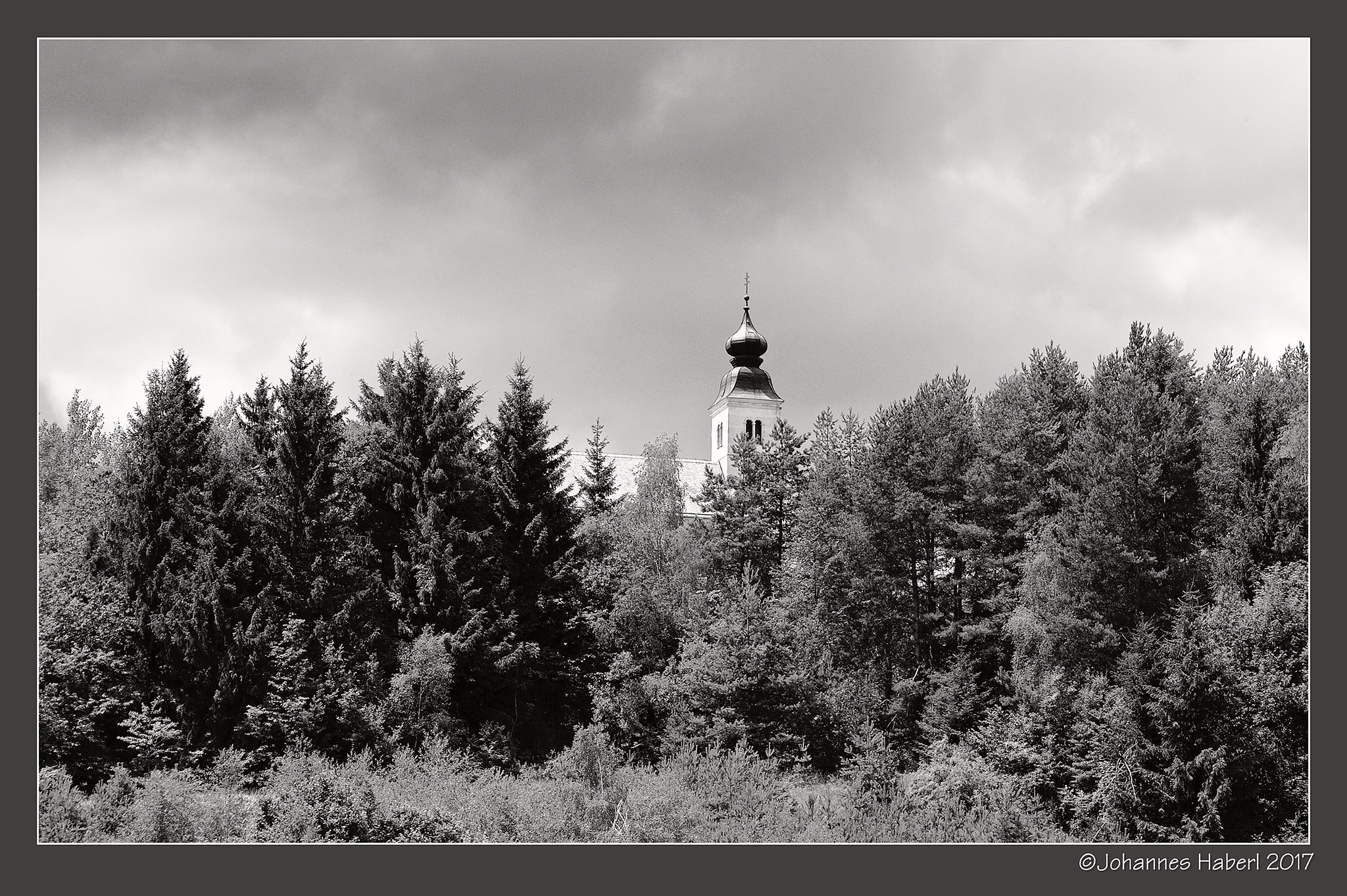 view to pilgrimage church Sveti Duh (Heiligengeist) / B&W by Johannes Haberl